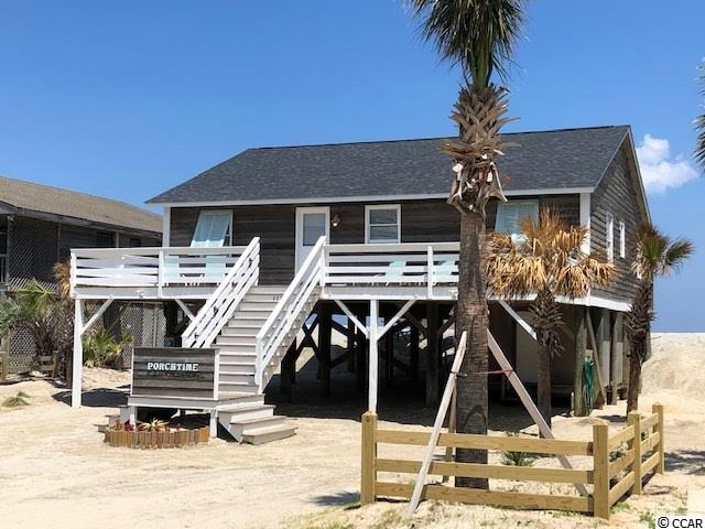 """Are you ready for some """"porchtime"""" relaxing by the ocean, taking in sunrises and sunsets? This 4BR/2BA raised beach house (sleeps 12 easily) is the true """"Arrogantly Shabby"""" Pawleys Island home, and is being offered with all furnishings, ready to go! HUGE porches on front and back for entertaining and family fun has created its name """"PORCHTIME"""". It has parking for 7 vehicles, and room for a boat underneath as well! This home has just been completely renovated inside: NEW vinyl plank flooring throughout; lighting, switches, outlets, NEW ceiling fans in all 4 bedrooms and greatroom; NEW 5"""" baseboards and NEW crown molding throughout, NEW lowcountry window trim and door trims; NEW""""shiplap"""" walls in greatroom area, NEW beadboard plank ceilings in kitchen, baths, and laundry room; NEW can lighting in kitchen and greatroom; NEW bathroom vanities, toilets, and shower; NEW kitchen cabinets, granite and backsplash; NEW appliances; NEW custom kitchen table seating 10, its like a new home! NEW front deck, NEW rear covered deck (can easily be screened) and open sun porch w outdoor shower. There is a large storage room/work shop underneath home also. NEW roof installed in 2017, NEW water heater in 2017, and NEW HVAC in 2016. Enjoy all that Pawleys Island has to offer - just steps from putting your toes in the sand, or put your boat in the creek at the public landing just down the street to fish, joyride, or go paddle boarding. Great opportunity to start building family memories of a lifetime. Short distance to shopping, restaurants, golf, and the Intercoastal Waterway. 85 Miles to Charlestown SC. Currently under rental management with Pawleys Island Realty Co. All listing information is deemed reliable but not guaranteed. Measurements and square footage are approximate. Buyer and/or agent are responsible to verify. Listing agent is in partnership with owners."""