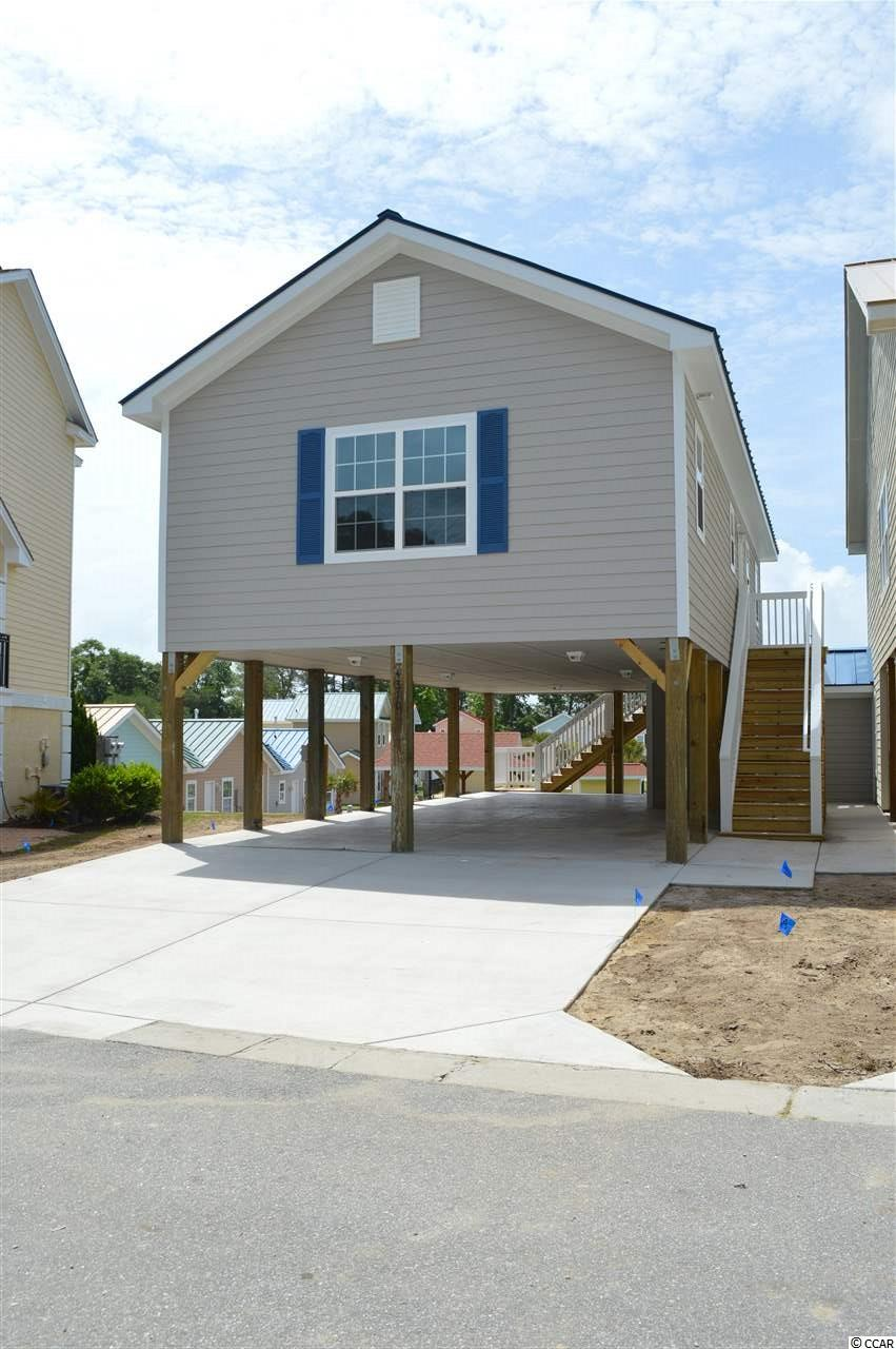 Fantastic marlin floor plan! This 3 bed/3 bath home offers a traditional layout with a guest bedroom and full guest bath in the hall and spacious master suite on the main level as well as another full suite on the lower level. The kitchen is well appointed with granite counter tops, custom cabinets including soft close doors/drawers, center island, and stainless steel appliances. The living space has vaulted ceilings and luxury vinyl plank in all areas except the bedrooms. Grande Harbour is a natural gas community with its own dry stack marina that offers discounted marina services to Grande Harbour homeowners! Exterior features include hardie plank siding, metal roof, tankless hot water heater, covered parking, and two attached storage rooms. The landscaping, yard maintenance, irrigation, pool, covered picnic area with gas grill, even basic cable, internet, telephone, and security system with basic monitoring is all included in your HOA dues! Seconds from the Intracoastal Waterway and minutes to Cherry Grove beach!