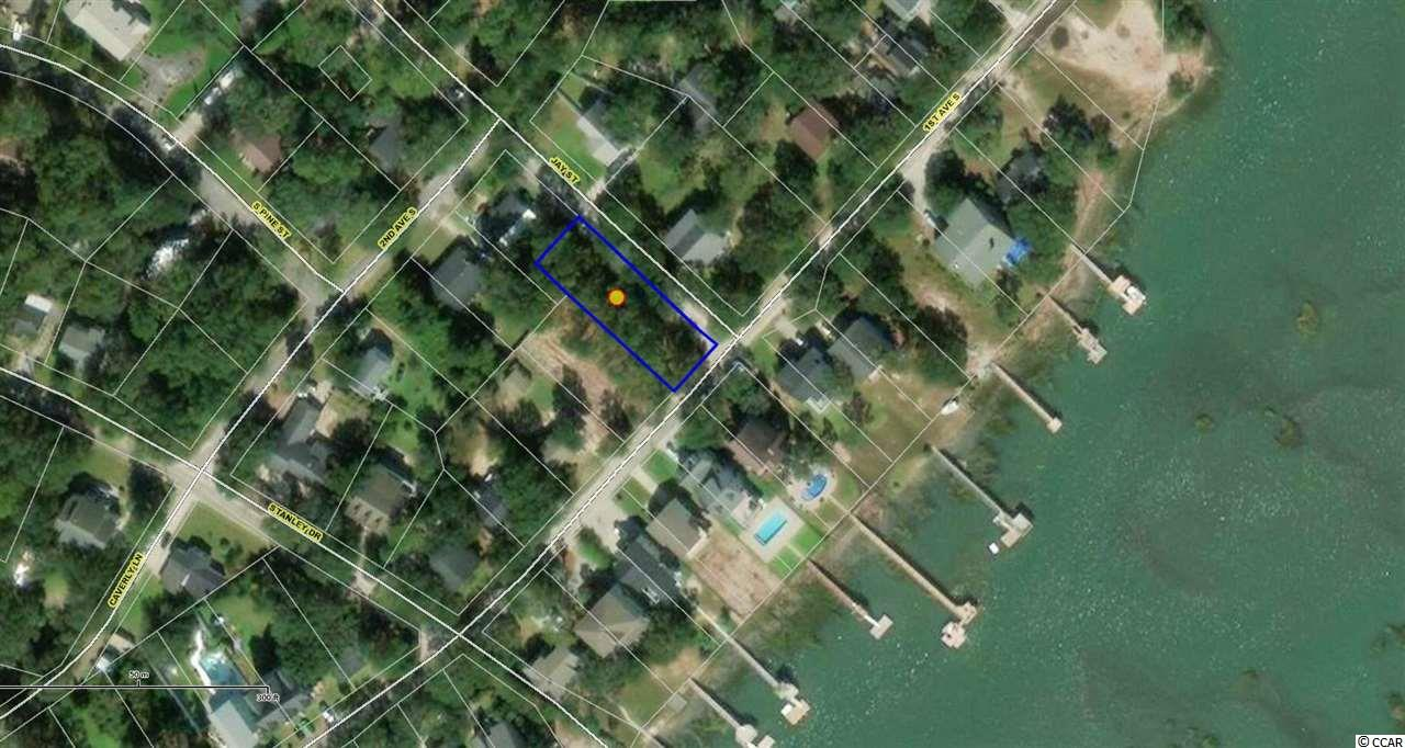 Excellent opportunity to build your dream home or vacation home in beautiful Murrells Inlet! Corner lot with public water and sewer. East of 17 with a great view of the Marsh! And No HOA fees! Easement to the Marsh across the street allows excellent views of the salt marsh.