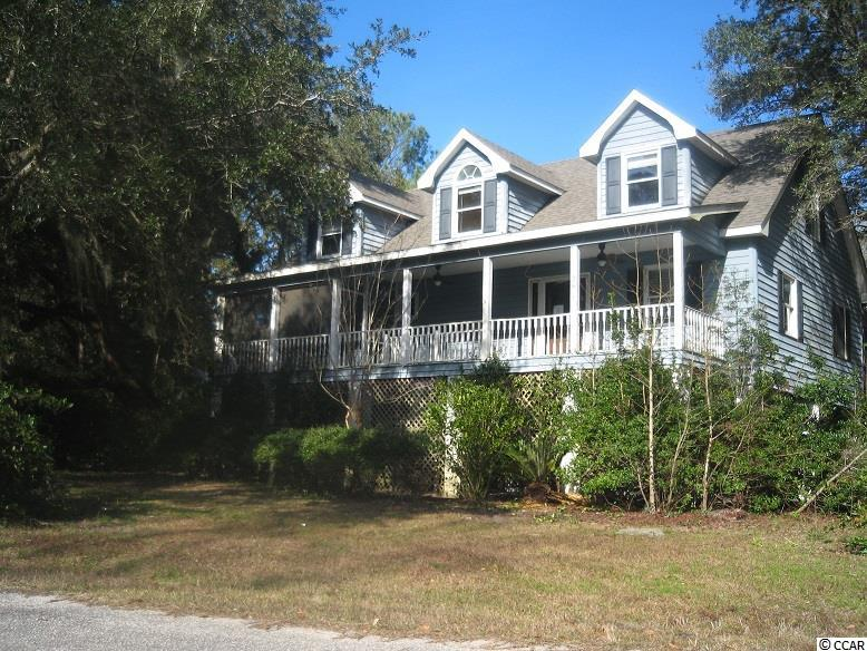 "Large raised beach home, east of Hwy 17, on big corner lot boasting massive oaks dripping with spanish moss. The home is within a mile to beach. This is a ""diamond in the rough"". Seller just installed a new roof, but the rest of the home needs cosmetics, flooring, and painting. It is being sold ""as-is"" but with some TLC it could be a dream house. Square footage is approximate and not guaranteed. Buyer is responsible for verification."
