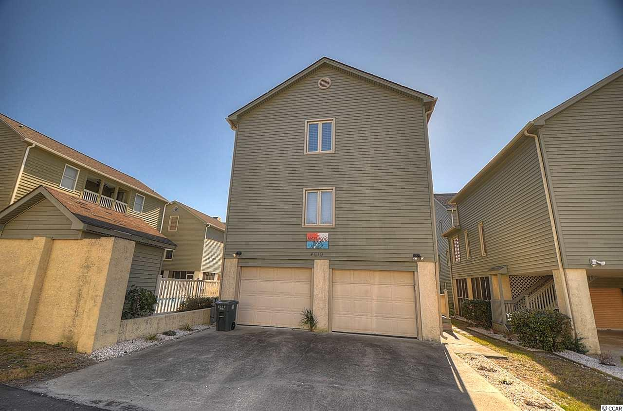 Literally just steps from the beach! 3 BR/ 3 BA furnished, move in ready. New siding and paint, new master walk-in shower. This furnished home has an ocean view from the second floor and is situated next to the community pool. A MUST SEE!