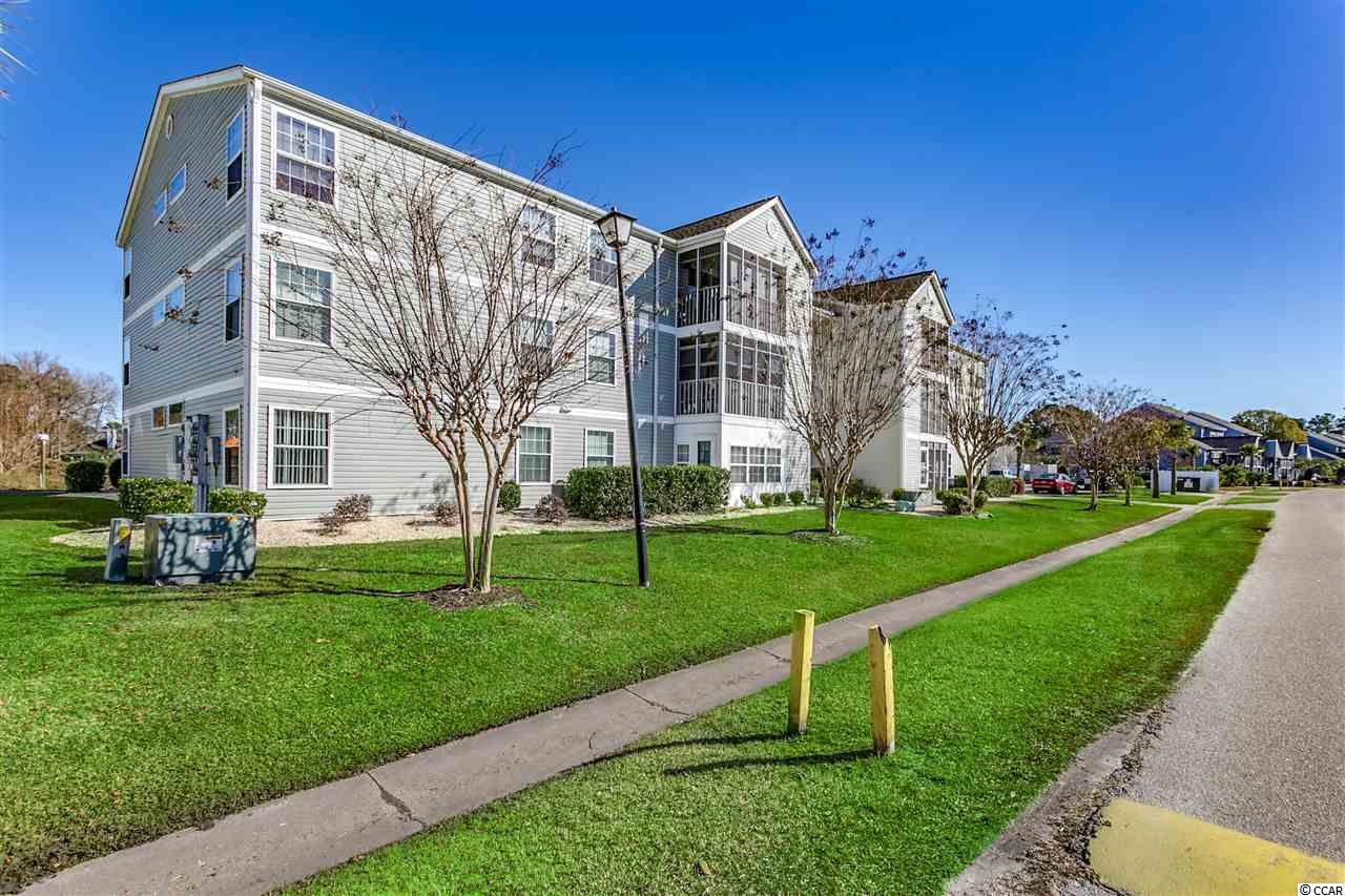 Great pool view unit in the peaceful Hampton Greens in Deerfield! This Spacious second floor end unit is perfectly located only a short drive to the best of the Beach, from Broadway at the Beach, the SkyWheel, Ocean Boulevard, direct access to Highways 17 Bypass and Business, providing you a quick route to both North Myrtle Beach and the many seafood restaurants in picturesque Murrells Inlet. Spacious living room with sliding glass doors leading to a screened porch, great for enjoying a morning coffee or the warm Carolina evenings. Attached storage unit. Informal dining area with open-concept kitchen with ample cabinetry, plenty of counter space, pantry, and a breakfast bar. The generously sized master bedroom with ensuite bath features natural light and a walk-in closet. Additional two bedrooms share a full bath and easy access to the laundry room. The Hampton Greens community offers you access to an outdoor pool, barbecue area, and tennis court.