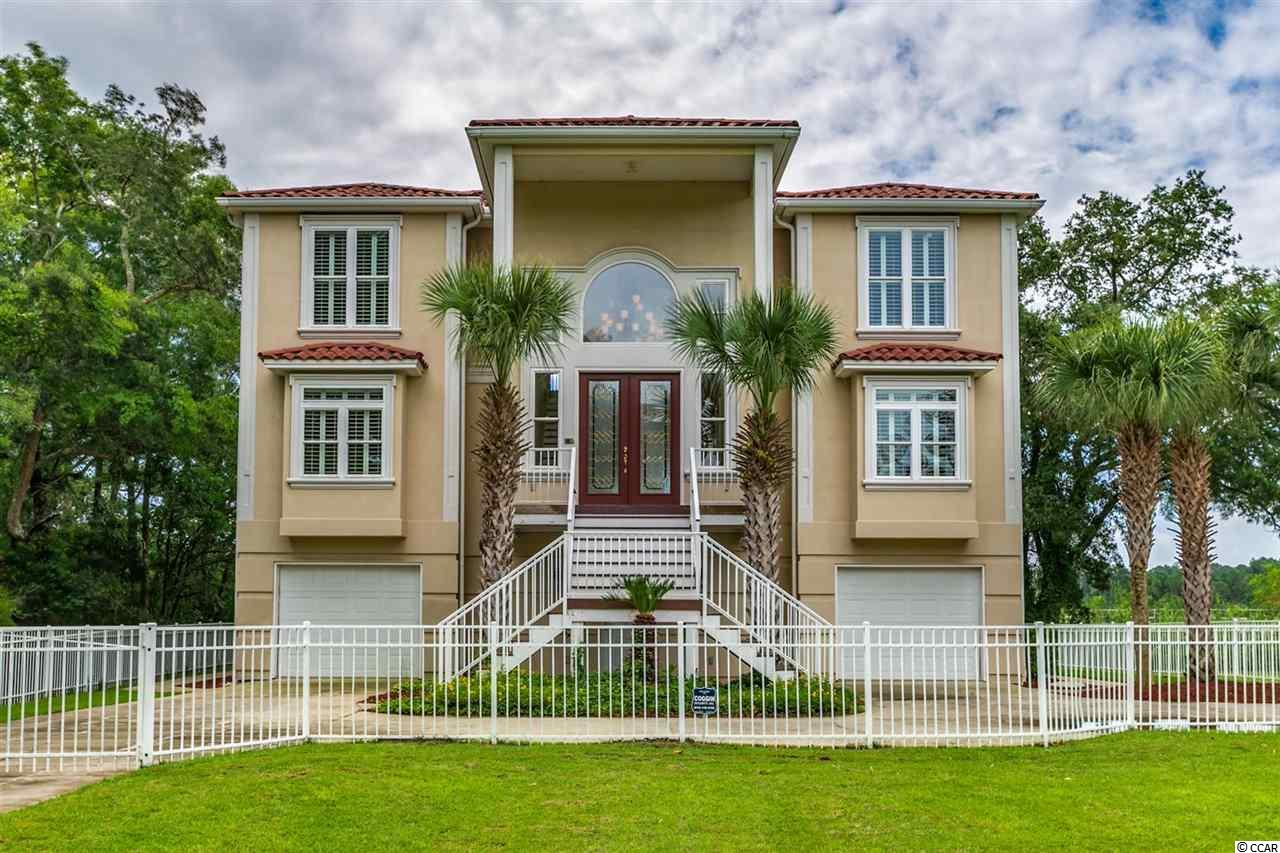 Welcome home to this 5 bedroom home with 3 full baths and 4 half baths, perfectly situated on the marsh and Intracoastal Waterway. This home features beautiful wood flooring with unique tray ceilings and an open floorplan throughout the main living areas. The kitchen is equipped with stainless steel appliances, granite countertops, a work island with range and breakfast bar and a walk in pantry. The very spacious master bedroom includes room for a seating area, oversized walk in closet, and spectacular views of the waterway, while the master bath features dual sink vanities, a jetted tub, and luxurious tiled walk in shower. There is a huge den/man cave on the main level with a wet bar and double garages on both sides. The 3rd floor includes 4 bedrooms and another huge den area with wet bar. You can enjoy the views from almost every room, and spend your afternoons on the screened in porch off the master, on any of the surrounding balconies, or in the waterway! Park your boat right at home with a floating dock included, and private fenced in property. This home also features all the upgrades, including a security system, lawn sprinklers, many unique details throughout the trim and moldings, custom built in storage in the pantry and closets, a shared pier, and more! Conveniently located near Mariners Pointe Marina, and near all of the Grand Strand's finest dining, shopping, golf, and entertainment attractions. Schedule your showing today!