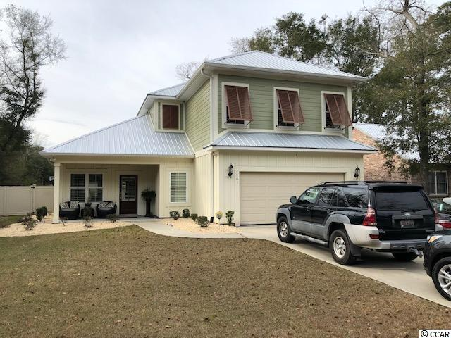 VERY NICE RECENTLY BUILT HOUSE WITHIN WALKING DISTANCE TO MARSHWALK.  UPGRADES THROUGHOUT INCLUDING CROWN MOLDING, HARDWOOD FLOORS, PLANTATION SHUTTERS, GRANITE, STAINLESS APPLIANCES, HURRICANE FILM ON WINDOWS, DOGGIE DOOR  AND THE LIST GOES ON AND ON.  ENTERTAIN IN YOUR FENCED IN BACK YARD WITH BUILT IN FIRE-PIT AND WET BAR. CLOSE TO ALL MYRTLE BEACH HAS TO OFFER AND A MUST SEE!  PRICED TO SELL AND WILL NOT LAST LONG,  MAKE SURE YOUR AGENT HAS THIS HOME ON THEIR LIST TO SHOW.