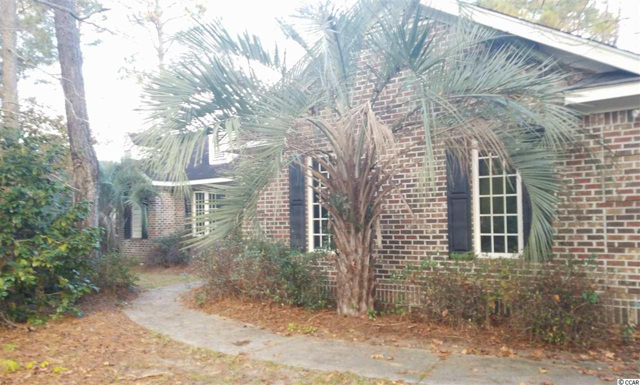 !REDUCED! The beautiful golf community of Pawleys Plantation in Pawleys Island, SC. Great proximity to schools, shopping, churches and the beaches! Community features include a community pool, Jack Nicklaus golf course, clubhouse, golf amenities, dining, and gated security. 4 bedrooms, 2.5 baths, single story traditional home in Pawleys Plantation. Built in 1998 this home features a charming kitchen, master bedroom privacy in the rear of the home, side load two car garage with a large lofted storage area above the garage, tile flooring, a laundry room. The lot backs up to a pond. Come see what you have been missing. Buyer to verify all measurements, uses and features.