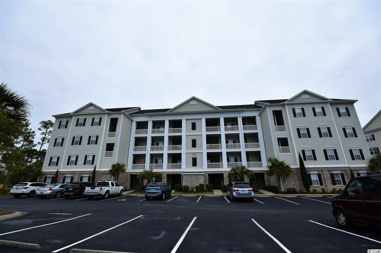 "This spacious, three bedroom, two bath, all on one level condo is located in the highly sought after community of Villas at International Club. The meticulously maintained grounds, large relaxing pool and gated community offer you peace and privacy in this Murrells Inlet, S.C condo. This second floor condo, with elevator, overlooks the International Club TPC Golf course from the newly redone screened in porch. Also, newer is the HVAC unit. Or, enjoy your morning coffee standing on the front balcony overlooking the well maintained private pool. It's all about LOCATION! The large master bedroom, on the backside of the condo, boasts an ample walk in closet and its own on-suite bathroom. Two additional bedrooms, separate from the master, allow for privacy. A brand new Neighborhood Walmart and Publix, only a few miles away, are quick and convenient for your shopping needs. Under a ten minute drive will find you at the wonderful ""Marsh walk"" Seafood Capital of Murrells Inlet, SC. This area boasts top notch restaurants, waterfront bars, as well as night life abound. Make an appointment with your agent today to see what this condo and area have to offer."