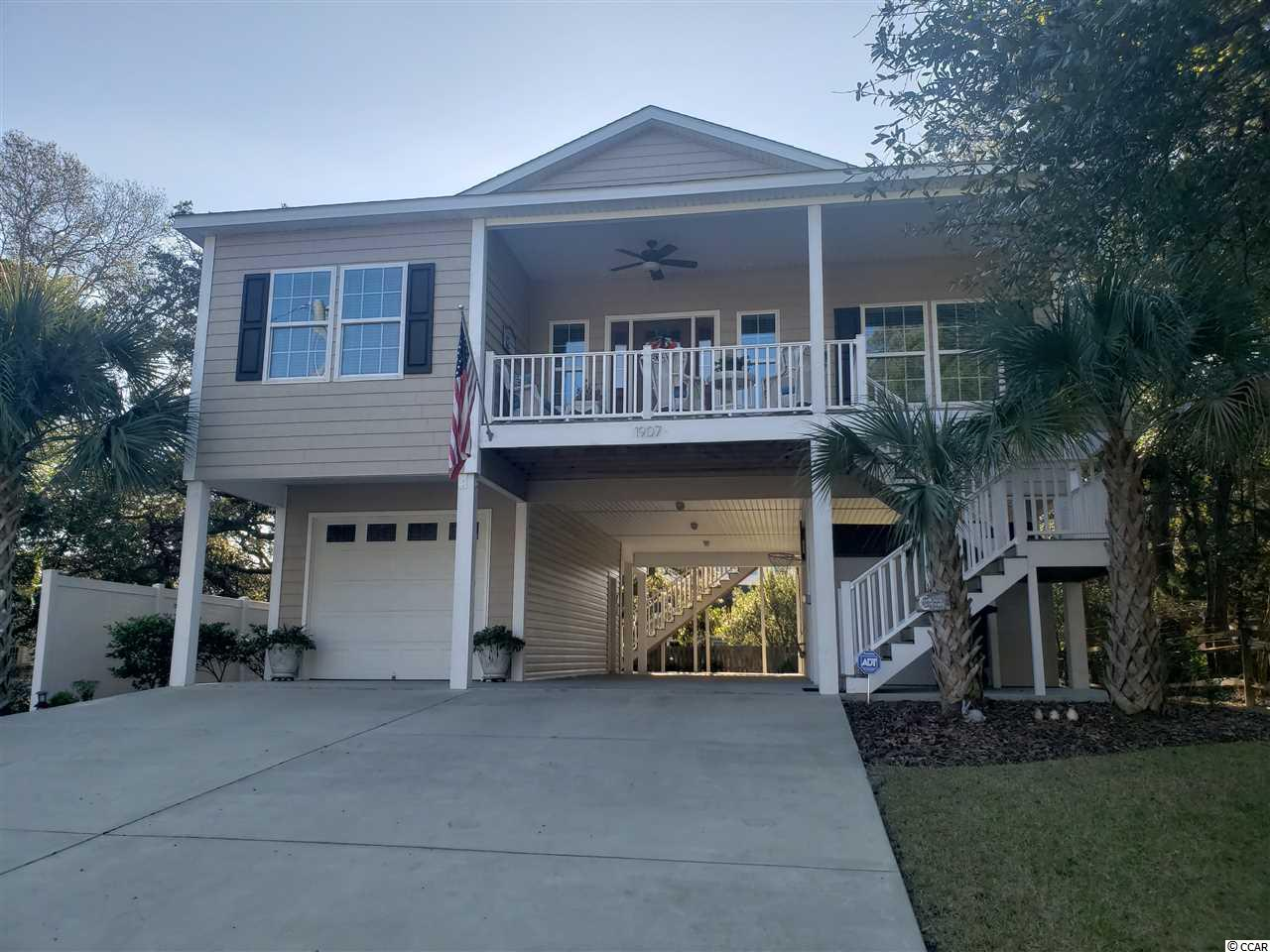 4 BR / 3 BA raised beach house in the Crescent section of NMB. Home features: 9 & 10' ceilings, crown molding, custom cabinets, granite countertops, Whirlpool stainless appliances, tile in baths, luxury laminate wood flooring in great room, carpet in bedrooms, concrete drive, full irrigation and landscaping, one car garage, etc. Large lot with hardwood trees and room for a pool. Chair lift / elevator off rear porch.