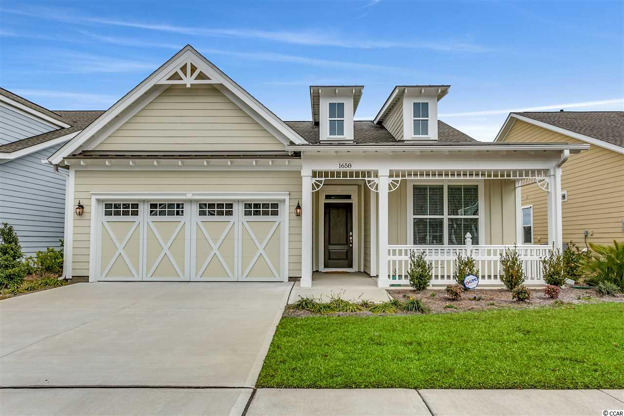 Ashford Model (open floor plan) with Coastal Cottage Elevation.  This house is brand new, built in 2018 and desirable location within community.   Fenced-in yard, Owners suite with walk-in bath, + 1 bdrm,  2 baths, great room (living room/dining room combo) and beautiful eat-in kitchen with center island, granite countertops, with extended counter into great room for bar stools. Upgrades include elevation, kitchen cabinets, stainless steel appliances, carpeting, and fans in both great room/owners suite. HOA Fees includes home security system/monitoring, lawn-care plus watering, cable TV.  Cresswind amenities include pool, tennis courts, wooded walking trails, Ocean and MB State Park accessible by both Golf cart/bike  Close to golf courses, shopping, restaurants, entertainment, Myrtle Beach Airport, and Grand Strand Hospital. Market Commons is within walking distance from the community and has boutiques, great restaurants, movies, bowling and a beautiful pond to walk/bike around.