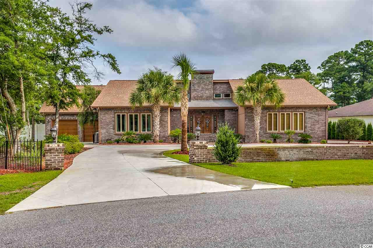 """My sellers thought this was where they were going to enjoy their retirement, in the beautiful Tilghman Estates community, so they spared no expense turning this 5br/3.5ba contemporary house into their forever home.  Over the last few years, they have made additions, replaced items, and made various updates, such as the addition of an oversized 2 car garage with bonus room above it, a new in-ground salt water pool with concrete pad around it, along with a detached shed, a new roof and all new windows, the addition of walk-in pantry, extensive landscaping to front and back yards with well pump irrigation system, new concrete circular driveway and decorative front brick wall, just to keep this list short.  In addition to all the updates and additions, this home is filled with many features that are sure to please, such as a sunken living room with a stone wall fireplace, which is gas and/or wood burning, a large closet wet bar with ice maker, formal dining room with built-in lighted hutch cabinet, crown molding and hardwood flooring, granite countertops, stainless steel appliances, hidden storage cabinet on the counter for small appliances, floor to ceiling cabinetry in the new walk-in pantry, reverse osmosis water purifier, master bedroom with new doorway to rear deck,  two guest bedrooms connected by a Jack-n-Jill bath that has a walk in shower.  Some features of the upstairs are a 2nd master bedroom with a full bath, a large guest or bonus room with a new walk-in closet and built in shelving, walk-in attack storage which also leads to the new bonus or """"man cave"""" room over the additional garage.  The new oversized 2 car garage has three bay doors, two in front and one in back, a built-in work counter and cabinetry, and a """"men's"""" half bath.  The house has two hot water heaters, is wi-fi wired, has an alarm system, laundry shoot from the 2nd floor, split HVAC for 2 zone, 400 amp service, 8 ft white vinyl privacy fence, large rear deck with 20 ft. electrical retractable"""