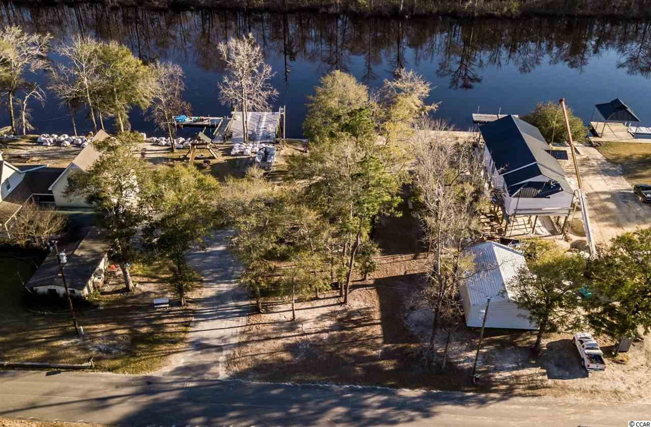 Improved waterfront lot on Black River. This long and deep freshwater river runs into Winyah Bay and the intracoastal waterway. Build your get-a-way or permanent residence and enjoy all your favorite watersports. This lot already has a septic tank, water, private boat landing and paved road access.