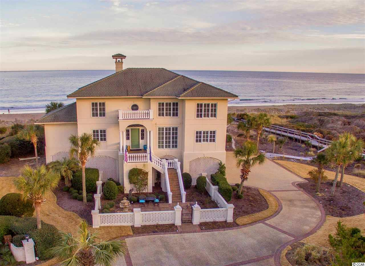 DeBordieu Colony –  Drastic Price Reduction on this elegant ocean front home, built on one of the largest ocean front homesites in the Pawleys Island area. 25 Sabal Court offers 5 bedrooms, 5.5 baths, 4,800 heated sq. ft. and a gorgeous direct view of the Atlantic! Recently upgraded, the foundation of the structure is as sound as the exterior is beautiful. 25 Sabal Court is located on what was two oceanfront lots in the secluded, set back, Ocean Green neighborhood, south of the sea wall in DeBordieu Colony, and adjacent to the 17,000 acre nature preserve of Hobcaw Barony. Here you can walk for over 2 secluded miles south to North Inlet and not see another house. The first floor of this stately home offers a beautiful foyer with a winding staircase, living room with fireplace and built-in shelving, formal dining room, kitchen with breakfast room and ocean front keeping room, and a fabulous master suite with ocean front sitting room, perfect for watching the sun rise over the ocean. Upstairs are 4 guest suites, each with their own private bathrooms, a cozy living area with fireplace and an exercise/storage room. On the ocean side of the house are large porches on both floors with ocean views that are spectacular. Other interior features include: Elevator, security system, and large laundry room. The master bath includes a luxurious tub with jets, separate shower, two separate vanities with sinks, a skylight and large custom closet. The secluded driveway leads to a charming brick fenced courtyard with stairs to the front porch. Other exterior amenities are a private walkway to the beach, outdoor shower, ample parking areas and large garage for multiple vehicles. This site is one of the largest ocean front lots in the Pawleys Island area: one full acre, with 100 ft. directly on the ocean. Dimensions of the land are 150 x 182 x 100 x 269 x 149. DeBordieu Colony is a beautiful, gated, ocean front community located about an hour north of Charleston, South Carolina, and abo