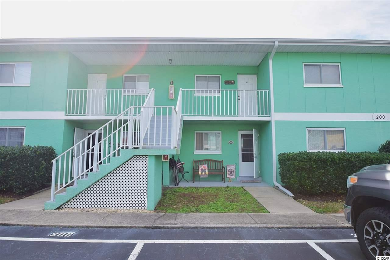 Well maintained 2 bedroom 2 full bath first floor condo in the heart of Surfside. This condo features an open floor plan, step in shower in master suite, full laundry room, and a fully enclosed porch. Complex is well maintained and features a Great pool. Excellent opportunity to own an affordable condo in one of the best parts of Surfside just a short golf cart ride to the beach.