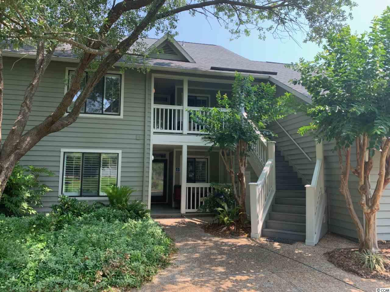 A rare opportunity to own a spacious and completely remodeled unit in Windsor Court in Kingston Plantation. If you have been looking for a unit with a back porch that over looks the Windsor Court pool all while being a golf cart ride to the ocean, this is it. Special bonus that this condo has been completely updated and is turn key ready for you to either use as a income producing property or call it home.  This unit has been freshly painted from floor to ceiling and even the trim. The spacious kitchen boasts an eat in area, new granite, and new stainless appliances. Waterproof woodgrain flooring was added as not only a style upgrade but with beach going and easy up keep as well.  Both bathrooms have been improved with granite counter tops and new glass shower doors. The list of new features continues with the little extras that make high impact including ceiling fans, door hardware, plantation shutters and a new water heater. If you are impressed so far than the custom furnishings and hand picked decor will be the things that make you feel truly at home. Walking into this unit you feel like you are walking into a model home and that home should be yours. You must see it to appreciate it so schedule your appointment today!