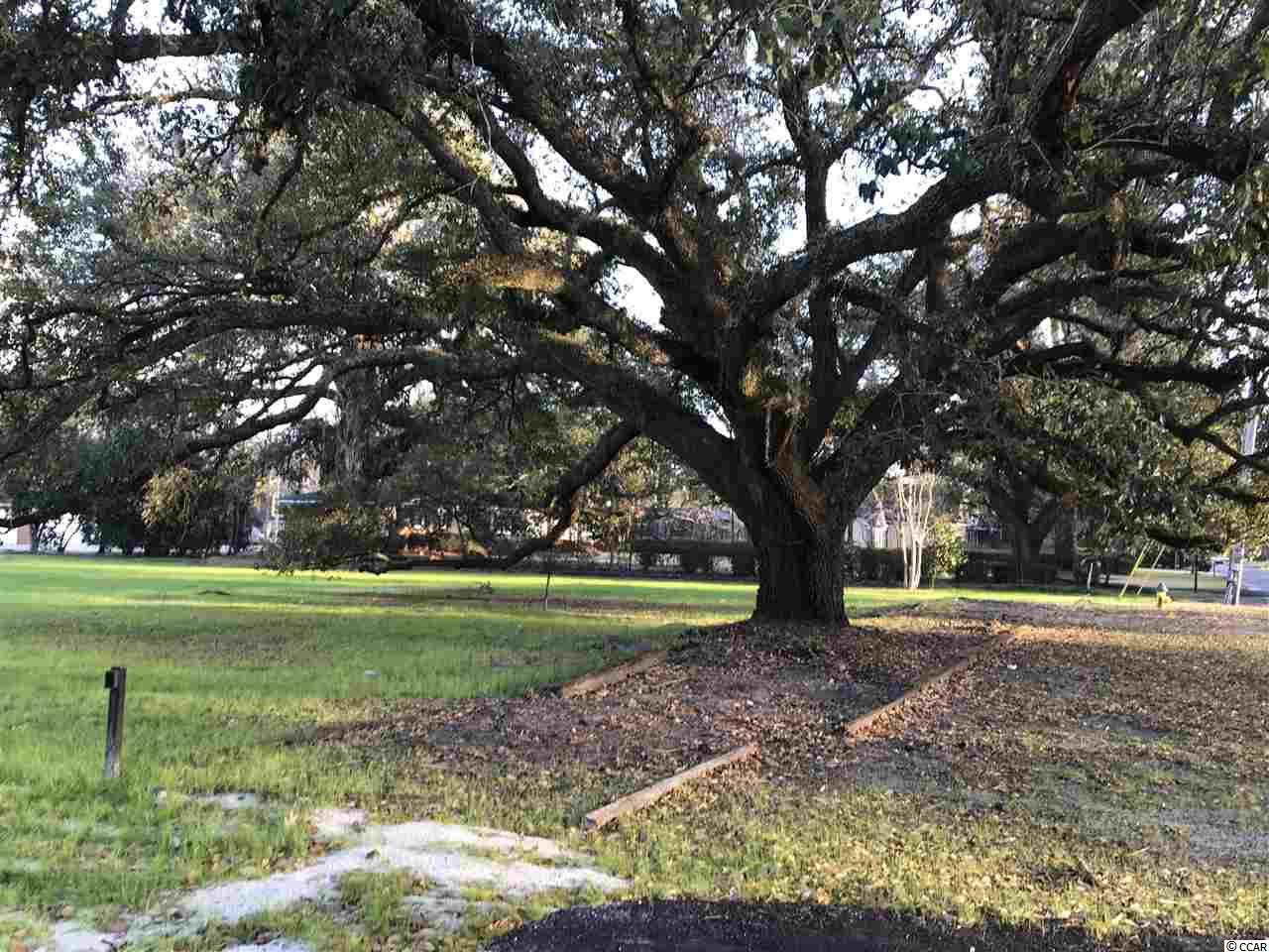 An amazing opportunity for one of the prettiest lots in town.  A clean slate to build the home of your dreams on a tree lined street with sidewalks.  Located on Kingston Lake.