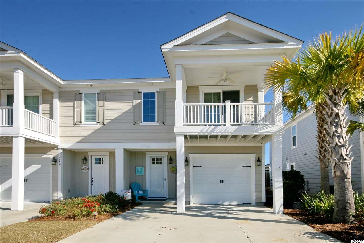 Price and quality in the same unit!This townhome is located in The Retreat at Barefoot Village, Intercoastal Waterway community, close to Barefoot Marina in Barefoot Resort. Former model home with endless upgrades. 3 bedrooms, 2.5 baths, one-car garage, golf cart ride to the beach! Granite countertops in kitchen and upgraded marble in baths, stainless steel appliances highlight the interior. Designer light fixtures and ceiling fans add to the look and of quality in this townhome. This unit has never been rented, and rarely used as a second home. The Retreat has it's own private pool and access to the largest salt water pool in this area-it actually overlooks the Waterway! The location is superb, across from Barefoot Landing, full of restaurants, shops, entertainment such as The House of Blues and The Alabama Theater, and Lulu's--a Jimmy Buffet addition. Make this #1 on your list to see-you will not be disappointed!