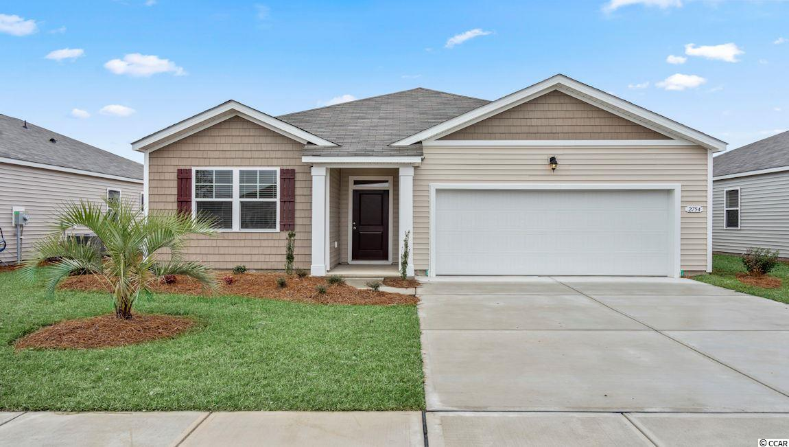 "This ""SMART HOME"" is connected!!! Lock or unlock your doors, control the temperature of your home and see who is ringing your doorbell, from your smart phone! Kitchen features stainless appliances (including refrigerator) and 36"" white cabinets with pendant lights over the gourmet granite counter height island, all overlooking the spacious Living Room and Dining Room - great for entertaining! Low maintenance Solid surface flooring (resilient hardwood-look vinyl) throughout the living area, bathrooms and laundry room. From the Dining Room, sliding glass doors take you to a 12 x 8 ft. covered porch. Owner's suite offers a large walk-in closet and bath with 5 ft. shower, double vanity and sinks. Washer, dryer and garage door opener included! We are the price-leader for single family homes in Market Common! Our home owners will enjoy a gracious pool and hot tub, air conditioned pickle ball court/meeting space, walking trails and a short golf cart ride to the beach. Live like you're on vacation! Photos of home are of a model home of same floor plan in another community and are for presentation only. Square footages are approximate."