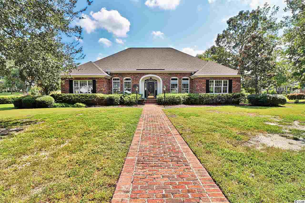 Little River... River Hills Golf Community...  Spectacular all brick quality custom built 4 bedroom 3.5 bath estate home perfectly situated on 2 River Hills Estate lots (-3/4 acres) backing up to the water of Cedar Creek and the 18th Fairway of beautiful River Hills Golf Course.  Enter this magnificent home into the foyer area greeted with flowing tile and hardwood floors open to the large great room featuring soaring ceilings and built in custom cherry hardwood entertainment cabinets.  Fully equipped gourmet kitchen with a working island breakfast bar and lots of custom designed cherry hardwood cabinets.  2 separate bonus rooms allow for a media room, an exercise room or 2 additional bedrooms.  Huge master suite with private sun room to relax and enjoy the views of the creek and fairway.  Master bath has Jacuzzi whirlpool tub, tile and glass walk in double shower and separate his and her closets.  Study or den for all the office work or just to relax and enjoy a book.  Laundry and work room to keep all the cleaning and washing chores out of the way.  Smooth ceilings, recessed can lighting and crown molding throughout.  Walk in attic storage to handle all of your storage needs.  During those warm Carolina days relax and enjoy the fresh air, sunshine and views on the over sized wrap around deck with trellis.  Built in brick BBQ grill for the grill master.  Navien instant hot water system.  Five stage water filtration system.  Separate water well to handle irrigation and any outdoor water needs without paying for it.  Encapsulated crawl space with a sealed vapor barrier and built in dehumidifier makes this home very energy efficient and climate controlled. River Hills Golf Course, pool and tennis court packages available. This is southern tranquil living at its finest with all you could ever desire.  River Hills is one of the most sought after golf communities located close to the Little River water front, dinning, shoppes, entertainment, sports grills, shopping centers, malls, outlets, fishing, Intra Coastal Waterway, marina's, golf and most beautiful white sandy ocean beaches of the Grand Strand!