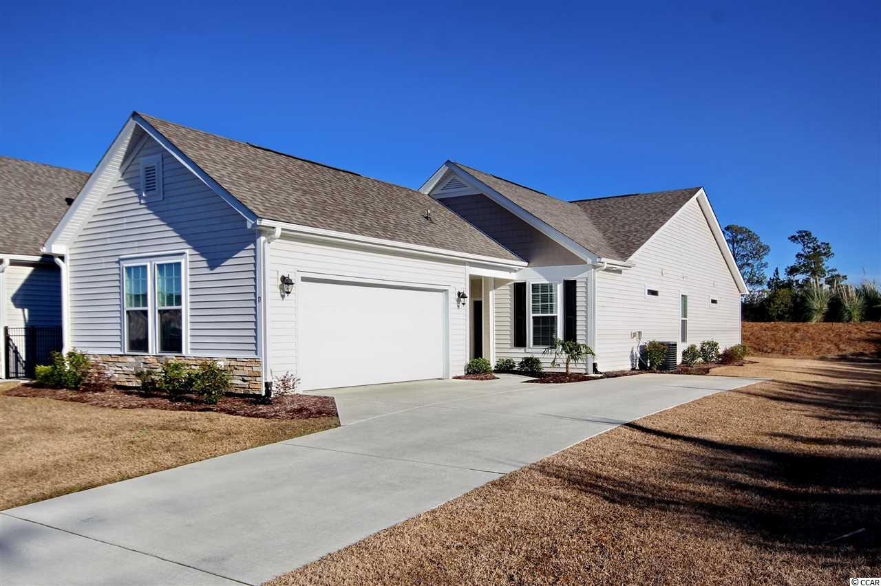 THIS IS A MUST SEE!! Beautiful end unit in the popular Cameron Village section. Close to all shopping, dining, and entertainment Myrtle Beach has to offer. The kitchen has granite counter tops, espresso colored cabinets, and stainless steel appliances. Beautiful vinyl flooring throughout kitchen, living room, master bedroom, laundry room, and breakfast area. Enjoy all of the natural light that soaks into this unit. Spacious layout with a vaulted ceiling in the living room, and 2 sky lights as well. Upgraded lighting/ceiling fan package throughout this home. The master bathroom features a beautiful marble walk in shower, and marble countertops to match. There is a double vanity with huge walk in closet, and linen closet in master bathroom as well. Washer and Dryer convey. The sellers picked out every upgrade possible including bay windows, and tray ceilings in the master bedroom. Enjoy drinking a cup of coffee on the screened in patio watching the sunrise! Construction has started on another community pool, in walking distance from unit. There is plenty of storage with an attic space above the garage.