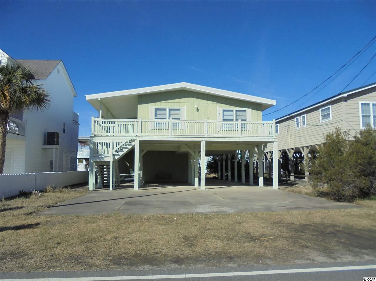 There is a little 'Ocean Peak' from the balcony. This home is in a very nice area of Cherry Grove only one block to the beach. There is a beach shower with hot and cold running water, big storage area & utility room on ground floor. This home could be fixed up to be a charming beach get away cottage or a tear down for a beautiful home only a block from the Blue Atlantic. Sold furnished, but a few items do not convey.