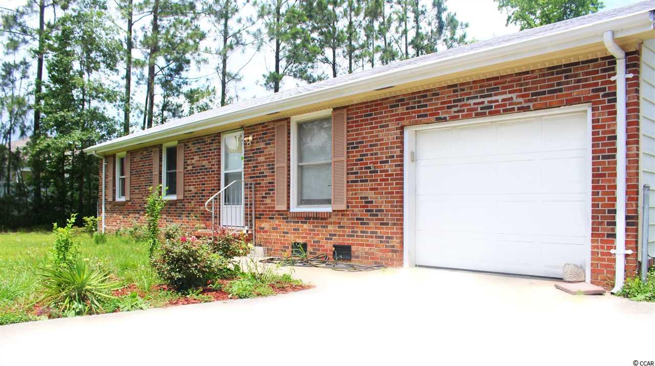 Cute bungalow situated on nearly an acre of land (40962 square feet) outside the city limits of Myrtle Beach, no HOA close to shopping and healthcare facilities. Nice screened in back porch, deck off Master Bedroom, lawn well