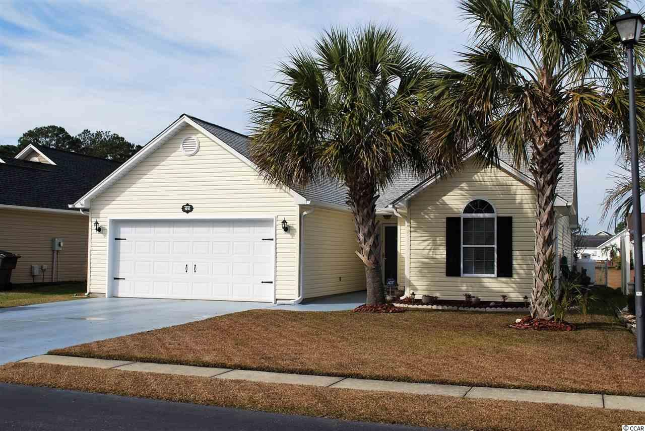 Just about one mile to the beach and close to amenities and Myrtle Beach International Airport! Easy golf cart ride, bicycle or walk to the beach. This spotless well cared for 3 bedroom 2 bath non-smoker home has an open floor plan on one level and sits on a beautiful bulkheaded pond. Cathedral ceilings and lots of windows let in natural light. All windows have either custom blinds or cordless cellular blinds. Custom woodwork trim throughout. The Kitchen has been updated with premium cherry hardwood cabinets. The large living room has a dining room area at one end. The master bedroom has a walk in closet. The master bath has a Garden Tub with shower and double bowl sink vanity. The kitchen has an eating area at one end with a swing wall mount for TV to watch the morning news while having your coffee and looking out at the pond. At the other end, there is an enclosed laundry and a double wide pantry and a custom built in bookcase with wine rack. The Carolina Room is plumbed with a propane line for a fireplace and has 6 large windows for viewing your fountain and the pond off your backyard. There is lots of wildlife including ducks, geese, swans, turtles, fish and a few rabbits. The backyard is fully fenced with two gates. Enjoy the outdoors on the enlarged concrete patio with a cantilevered picnic table, umbrella and two removable sun shades. All appliances including range, dishwasher, refrigerator freezer, microwave and front load washer and dryer convey. All floors have been updated by the present owner. The 2-car garage has a corner workshop area also with lots of cherry hardwood cabinets, pegboard for your tools and lots of lighting. On one garage wall, there is a wall mounted fishing rod holder. Outside the garage door is an outdoor shower to rinse off sand after a day at the beach. If you need room for storage, there is fully floored space over the garage and a second area in the attic of the home. Front yard sprinkler system. Four wall mounts for TV's in home 