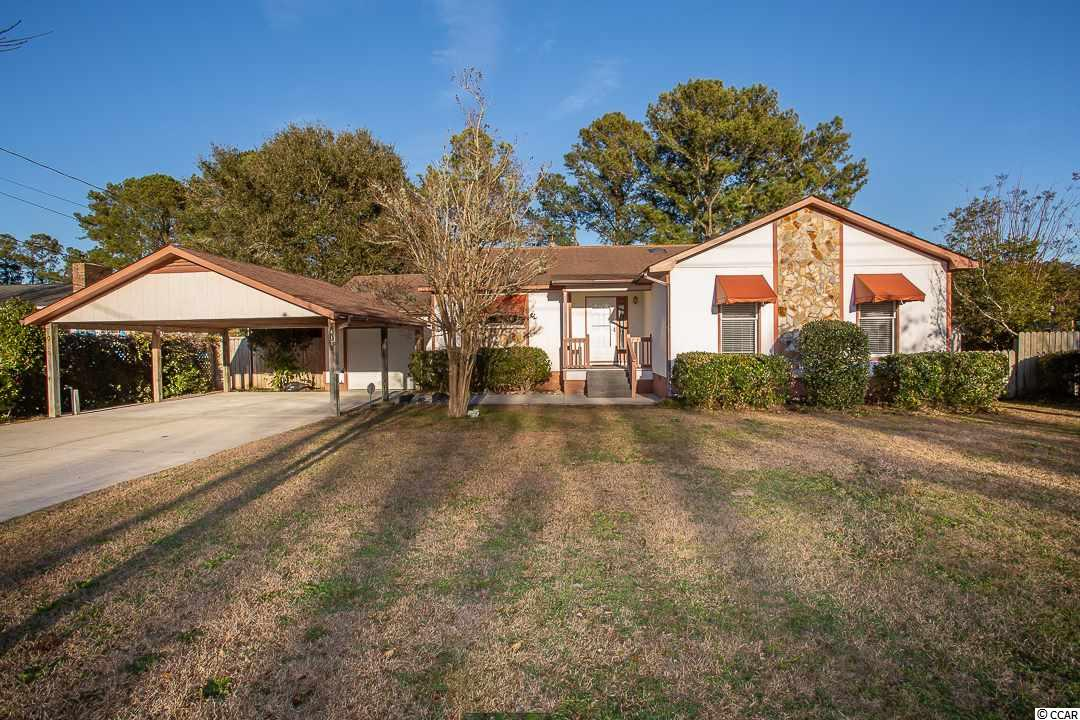 Pleasant home located in Little River close to Highway 9.  This 3 bedroom, 2 full bath home has new floors throughout and is in an established neighborhood.  It boasts a fully function-able fireplace with 2 sliding glass doors on either side that lead onto the long back porch and fenced-in rear yard.  The master bedroom has a sliding door that opens to the porch as well. The one car garage has been used for storage as the carport gives parking coverage.