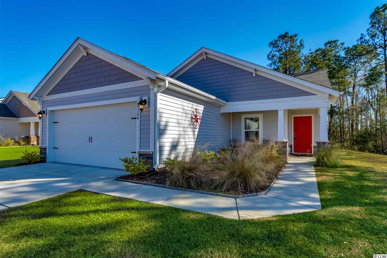 Located in Little River, SC just 30 minutes from Myrtle Beach and all of its attractions. This 3 BR 2 Ba home was built in 2017 and has been meticulously maintained by the seller. One of the most secluded homes in the neighborhood thanks to the adjacent woods and pond. The feeling inside is open, comfortable and welcoming. Nicely laid out Beaufort Floor Plan by Beazer with open kitchen and great room. Hand scraped wood and tile floors with smooth ceilings throughout! Community offers low HOA fees, outdoor pool, screened in pavilion, tennis court and weekly trash pick up. This home is ENERGY STAR CERTIFIED with low e windows, programmable thermostat, water saving faucets and more which means LOWER energy costs. Ask your agent for utility cost details. View the photos then come see for yourself.