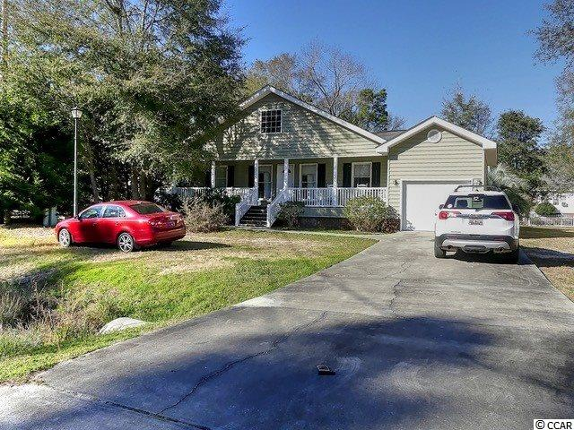 If you are searching for a four bedroom home on a quiet road in Murrells Inlet, look no further. The street is removed from all of the hustle and bustle, yet is a stone's throw from golf courses, shopping and the beach. The home is situated on a nice yard and a covered back porch. Inside you enter the large family area. Two bedrooms and a bath are off this space to the left and two bedrooms and a bath are on the right of the house. At the back of the house is dining and kitchen with a door to the nice sized covered porch. If you are handy and have an imagination, this property can truly be transformed into a show stopper! Calling all Property Brother hopefuls, this is your blank canvas! This home also has membership to Wachesaw East's pool, tennis courts and clubhouse amenities.