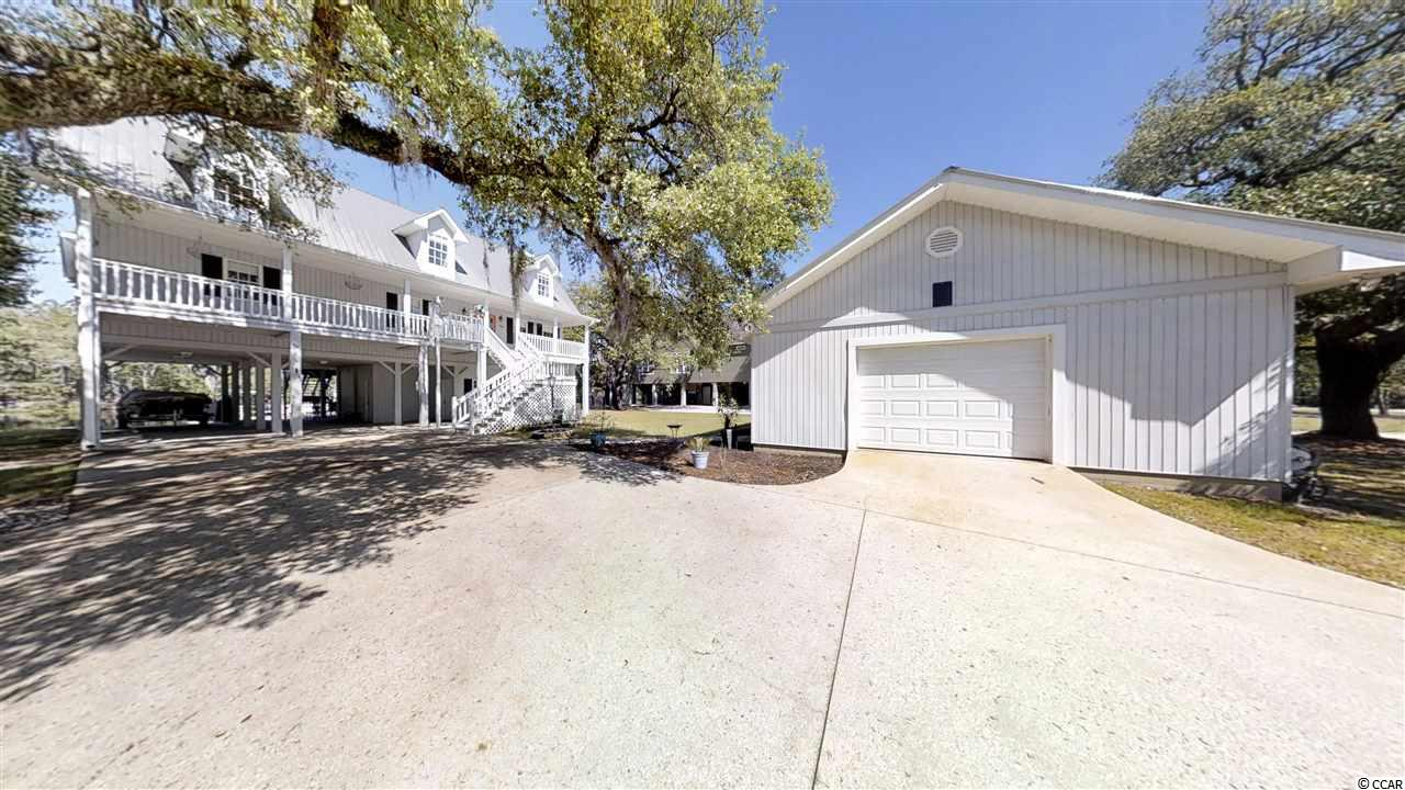 "This magnificent Newly Updated 5 Bedroom, 2.5 Bathroom raised home w/Saltwater Pool is located on the widest part of the Waccamaw River & boasts amenities too many to list! **NO HOA***From the private, permanent floating dock to the boat ramp; refortified sea wall; saltwater pool (2016) , Carolina Room Overlooking w/heating & cooling overlooking the river, Gas Stove/Double Oven & fireplace, & a Residential Lift to make carrying groceries upstairs a breeze, & a detached garage/workshop, this is a true Southern beauty. The kitchen has a well-planned layout with the eating area overlooking the river, Merillat upgraded 42 inch cabinetry and solid surface countertops along with a Whirlpool french door refrigerator and gas/double oven stove, and a large 4'5 x 7 walk-in pantry. Chair railing & crown molding; solid oak flooring downstairs; NEW hardwood flooring upstairs (2016) in all 4 of the bedrooms, 2 HVAC Units installed in 2016, New Metal Roof, and a propane fireplace in the living area with new tile accents and a Carolina Room for enjoying the beautiful views in all directions give more than enough room for entertaining. There is a spacious 23 x15 Master Bedroom with hardwood flooring & cozy sitting area on the Main Level; The Sleek Master Bath was Completely REMODELED in 2018 w/ separate designer tub & shower w/seamless shower doors & pebble rock floor; double sinks; designer lighting & fixtures and a large walk-in closet w/shelving. This layout is ideal for the homeowner wanting privacy from guests or family - 4 bedrooms upstairs could also be used as office space, workout room, theater room, den, or just storage. There is more than enough storage in this home. 3 of the BDS upstairs have 2 closets each. On the first level of the home, there is storage space, an additional refrigerator/freezer, and even a toilet conveniently located to the pool. Spacious Mud room with large sink, clothes drying area and lots of storage; fold up ironing board; and newer Kenmore washer & Samsung dryer. As you walk up the extra wide staircase, there  are 4 Bedrooms with plenty of closet space and a full bath. This area if not used often could easily be shut off and has its own HVAC system. Alarm system, a lawn sprinkler system using the river for irrigation, a 24'x25' Workshop/Garage, and a hook up for a generator. Downstairs attached storage area and room to park your boats or ""toys"" underneath along with the 2 car detached garage and extra long driveway & lights on an automatic timer.Enjoy the peaceful life of living on the river; with NO Homeowner's Association; and .38 acres of beauty including live oak trees hundreds of years old in your own front yard. This home was originally built by a custom builder and was his personal home w/the utmost of detail in construction throughout. The highest quality and standards of building are apparent inside and out. New windows were installed in the dining room, master bedroom, & throughout  home along with NEW back deck & NEW salt water pool surrounded by brick pavers. This home is meant for entertaining & enjoyment! Enjoy sitting by the pool, on the dock, or by a fire near the pool where a fire pit is already in place.  Irrigation system uses water from the river for cost savings.  Exterior lamp posts at the driveway (on a timer) beautifully accent the gorgeous live oaks that adorn this unique and beautiful property from the inside to the views in all directions. Enjoy soaking up the sun in the easy to maintain salt water pool overlooking the beautiful Waccamaw or put your boat in for a day of fishing out on the water. This home is minutes to downtown Conway and conveniently located to Hwy 501, 31, 22 and the New International Drive is just minutes away. Enjoy the peaceful beauty of nature but you are only minutes to everything in Conway and Myrtle Beach. Low taxes, low insurance costs, this is a rare beauty that would be a great home or 2nd home!"
