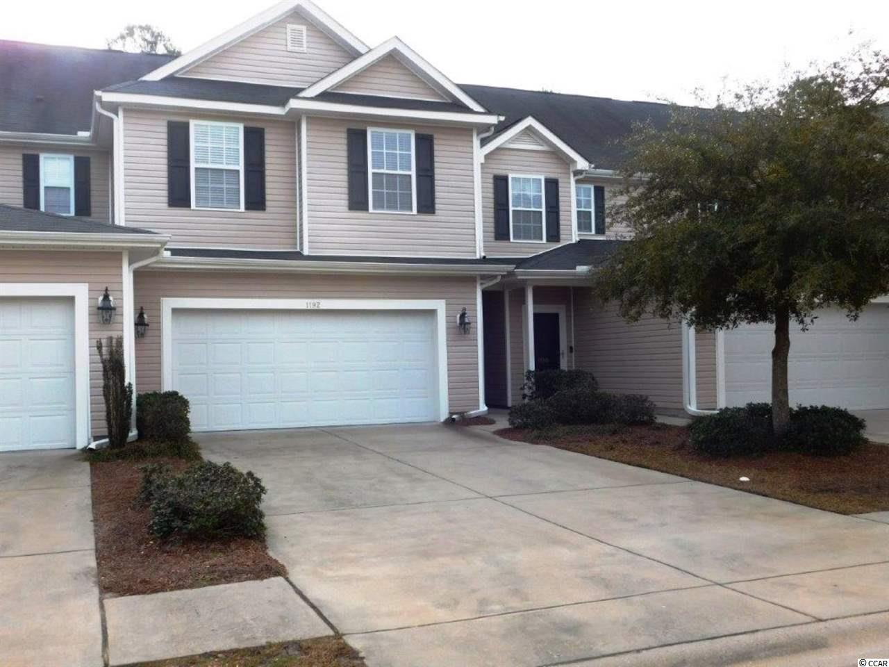 Gorgeous 3 BR/ 2.5 BA townhouse with 2 Car Garage located in Fairway @ Wild Wing in Carolina Forest area. Townhouse looks new- just freshly painted interior, new wood laminated floors throughout entry, living area, stairwell, and in master bedroom and both other bedrooms. Walk into this beauty and be greeted by soaring ceilings, a large coat closet, windows providing a bright, light atmosphere throughout the home. As you walk into this open. airy floor plan you will find a window and 2 windows high on wall facing back for sunlight to stream thru. Family room opens totally to kitchen and breakfast area with sliders opening to a concrete patio and a private treed back yard. Kitchen comes complete with a dining table & four chairs and a breakfast bar perfect for 4 bar stools. Double door, large pantry, side by side refrigerator, smooth top range, microwave, dishwasher and garbage disposal, plenty of cabinets and counter space. Great home for family, friends and entertaining. On bottom level there is a half bath for your & guests convenience. A utility room complete with washer & dryer, and door from garage giving direct access to kitchen for ease. Large garage has shelves for additional storage. Venture upstairs and turn right and enter a large master with matching new wood laminate floors, walk-in closet, linen closet. Master bath has double sinks, tub/ shower. There are 2 other large bedrooms with wood laminate flooring and a full bath and linen closet for convenience. Patio and backyard are great for out door living. Trees provide a wonderful back drop for peace and quiet. See this home and you'll love it and comes with a portable generator (Generac) for those times its needed. Truly townhome has been a second home with meticulous care. See it you'll want it and location is spectacular. Fairway community has a great community pool and is close in proximity to Horry Georgetown Tech, Conway Hospital, golf, restaurants and all the beach has to offer.