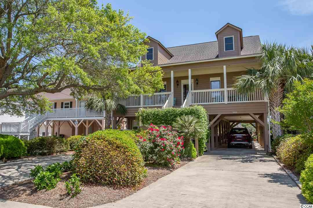 "There's only one like it!  Custom designed and built in the true low country style.  The gentle climb of the stairs lands you on a full length porch where it is difficult not to take a seat and relax.  The next ""oh my gosh"" is the leaded glass front door which opens into a wide foyer.  Note the solid oak floors throughout including the kitchen and baths.  The master bath features a whirlpool tub, shower, private water closet, 2 separate vanity areas, a walk-in closet and over-sized linen closet.  The kitchen features custom built wood cabinets, a working island, new quartz counter tops, new pull down faucet and over-sized sink.  The kitchen opens to the family living room which features a masonry fireplace with a gas log insert for those chilly nights.  French doors with transoms open onto the back porch where the view is spectacular from left to right!  Not to worry about groceries and luggage; the elevator opens into the kitchen area.  On level two are 3 bedrooms and a full bath which features wide plank pine flooring throughout, again the hallways are extra wide.  This level also includes a bonus room with vaulted ceilings, which makes a great man cave or second gathering space.  Walk out onto the Juliette balcony and look down House Creek towards Hog Inlet....Breathtaking!  Ground level offers an extra long garage, access to the elevator, a very large multipurpose workshop/playroom - perfect for a game room.  Multiple decks and patios offer leisure living at its best!  Take your boat straight out into Hog Inlet and the ocean from your own back dock.    A dual HVAC system keeps living space and the workshop areas climate controlled.  This one owner home was built with plywood sheathing - NO OSB board and is handicap accessible."