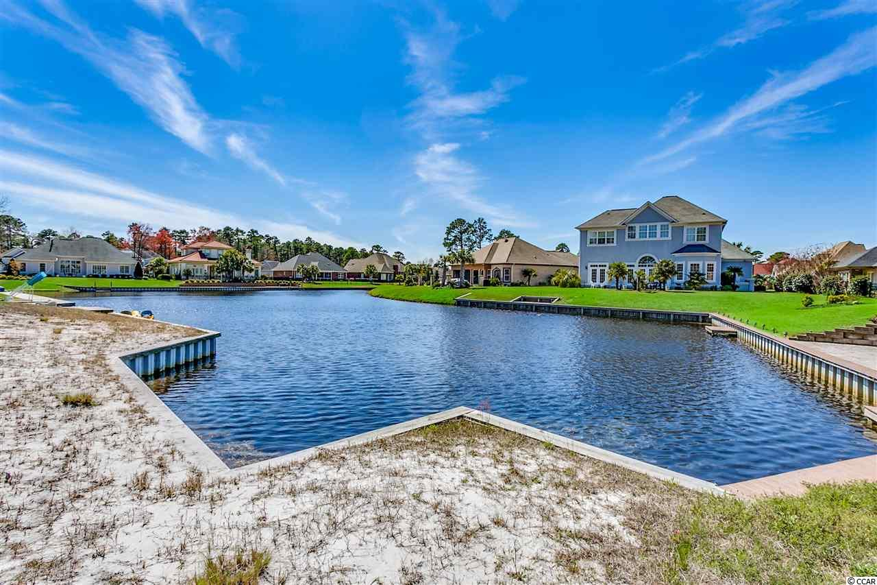 Build your dream home on this beautiful lakefront lot in highly sought after Plantation Lakes, in the Carolina Forest area of Myrtle Beach!  This lot provides a nice view of the lake, and already has a bulk head in place, which is vinyl clad for a long life.  There is also a great opportunity for more privacy or a larger building envelope by combining lots, as the adjacent lot, 770, is also for sale, and it has a boat slip and bulk head already in place as well!  This is a unique opportunity, as there are not many lakefront lots remaining in Plantation Lakes.  Plantation Lakes is a custom home community, with an interconnecting lake system and 14 miles of shoreline.  The amenity center features two large pools, one adult only, kiddie pool, clubhouse with workout facilities, tennis & basketball courts, and day docks.