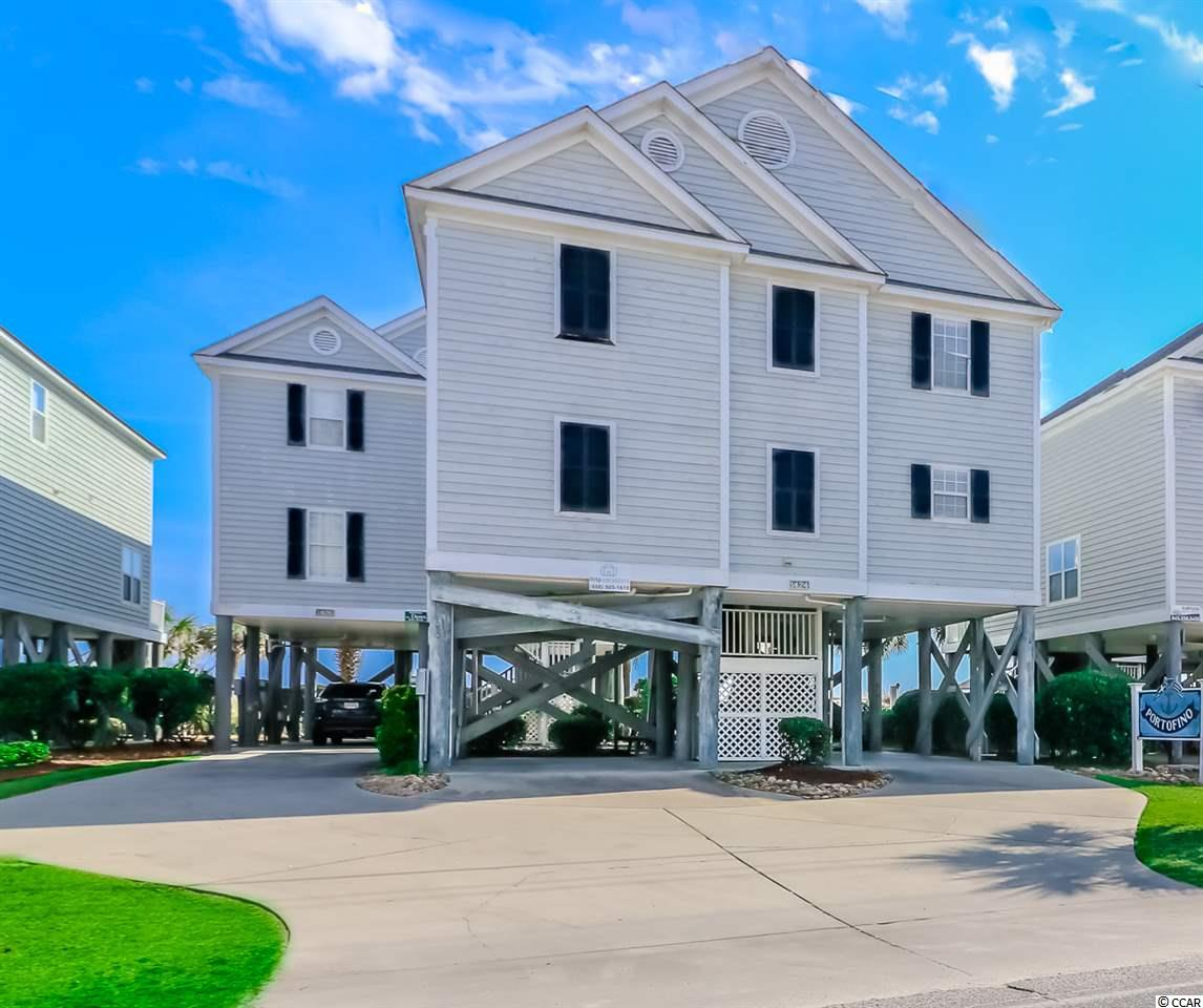 This 4-bedroom, 3-bathroom raised style beach home is located oceanfront in Portofino I on Garden City Beach.  ***Just updated in April 2019 with fresh interior light gray paint and new flooring - gray plank style flooring in living and dining area as well as neutral carpet in bedrooms, hallway and on stairs!  Also in May 2019 the entire exterior of the house has been freshly painted!***  Other improvements made in the last 2-3 years:  Granite counter tops in Kitchen, New back staircase, 2 new Heat Pumps (Air Doctors), New front door, Stainless stove (all kitchen appliances now S/S), New Chairs in living room replacing old sofa, New drapes to replace the problematic vertical blinds.  Enjoy the unobstructed view of the Atlantic Ocean and beach with private, direct beach access.  Portofino 1 (0.9 miles north of Garden City Pier), is a complex of 10 beachfront detached homes that share a huge, beautiful oceanfront pool and lovely manicured grounds.  Open living/dining/kitchen area great for family gathering and entertaining. Wood flooring in living & dining area, tile floors in kitchen & bathrooms, carpeting in bedrooms.  Two oceanfront covered porches; one off of living area and the other off of master bedroom.  Four Bedrooms: 3 up and 1 down; three bathrooms: 2 up and 1 down. Being sold fully furnished, rental ready, setup to accommodates 12 guests.  Fully stocked kitchen with stainless steel appliances as well as granite counter-tops.  This home also has a laundry room with tile flooring and a full size washer & dryer.  Ideal second home beach getaway or vacation rental investment.