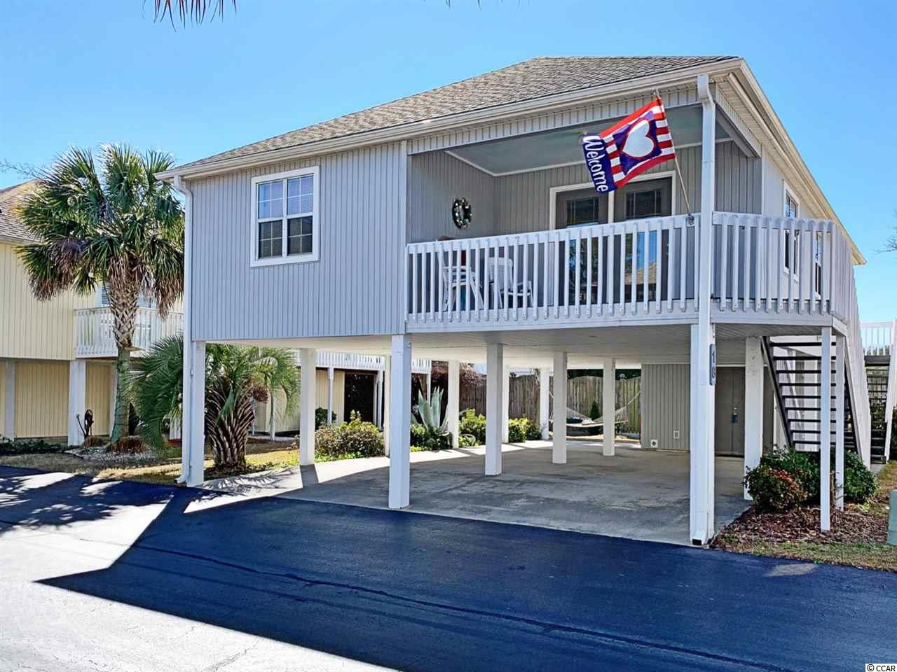 HOME IS WHERE THE OCEAN IS. This meticulously presented, raised-beach home in the private community of Willow Creek is ready to be enjoyed NOW as a primary residence, vacation getaway or the perfect investment opportunity equipped for sun-seeking renters. Maintained with love and attention by the original home owners, the 3 bedroom and 2 bath home has space to sleep 10 adults comfortably, comes partially furnished and decorated, includes all appliances, including a full sized washer and dryer and has always been used solely for the owner's enjoyment. The raised beach home offers plenty of covered parking, as well as a storage area complete with a separate shower and bathroom. Wash the sand off before going inside with the outdoor shower located by the two sets of stairs leading up to the house. This charming community offers a private swimming pool, picnic tables and is a golf cart ride away from the Atlantic Ocean in North Myrtle Beach.