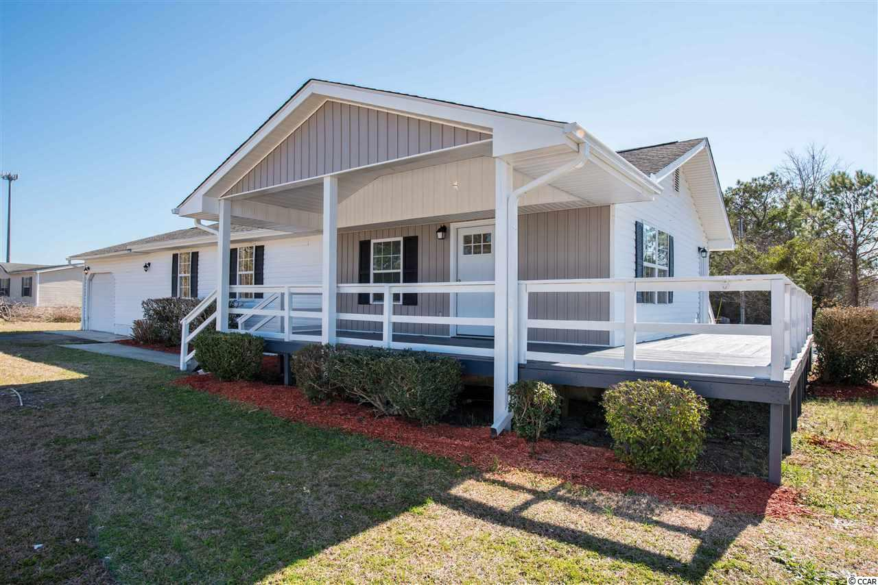 This newly renovated 3 bedroom, 2 bath home just minutes away from everything Little River and North Myrtle Beach has to offer is a MUST SEE! This home is equipped with a new roof, HV/AC and water heater, all installed in 2018. The open floor plan offers luxury cabinets and granite countertops accented with a kitchen backsplash. The large master bedroom includes double vanities, a walk-in shower tiled floor-to-ceiling and an enormous walk-in closet. Oversized 1.5 car garage has plenty of room for storage or perfect spot for your golf cart. This home includes over a 1/2 acre lot, that has no HOA's!!!