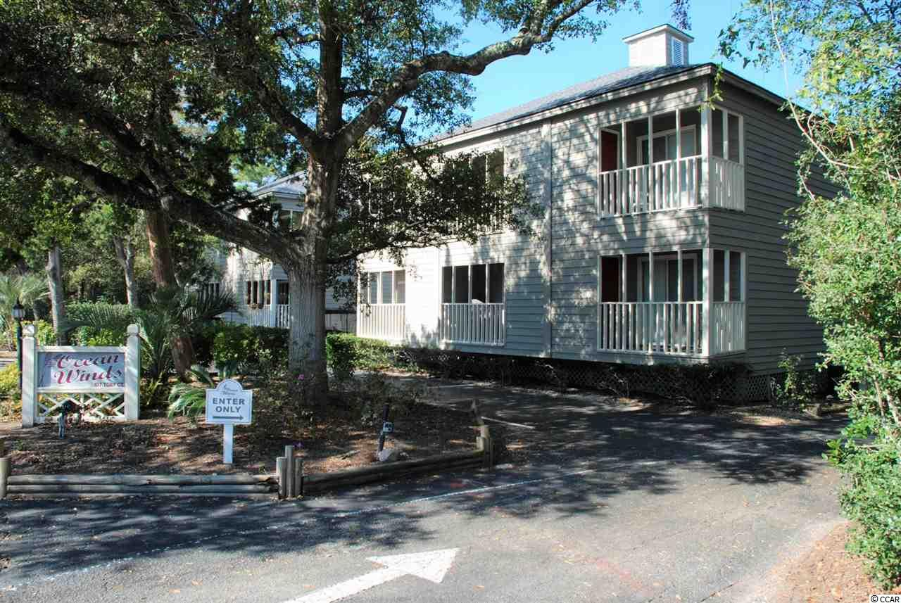 Great 2 bedroom 2 bath condo surrounded by beautiful old oak trees with a pond view from the master bedroom balcony. Hardwoods throughout condo with tile in bathrooms. Very functional built-in cabinetry in great room. If that's not enough the location can't be beat. Short walk or golf cart ride to the beach, Main Street, shag clubs and shopping. You won't want to miss the summer shag nights with live entertainment that is just a few blocks away. Great place to live or have as a weekend destination. Square footage is approximate and not guaranteed. Buyer is responsible for verification. Seller is a licensed SC Realtor.