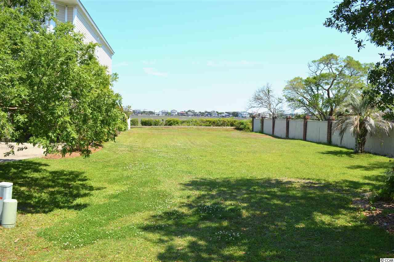 They don't make many of these! Beautiful coastal marsh lot with views that extend across creeks and marshes to the ocean. There is a neighborhood dock that extends into the Pawleys Island creek, allowing you access to kayaking and fishing. The lot is next to the very quiet community pool and right across from the tennis courts. All of this is tucked away from the hustle and bustle, but also within walking distance to Pawleys Island shops and restaurants.