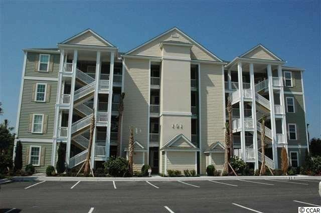 Located in one of the most successful condo development in the Myrtle Beach area, this second floor end unit is a beautiful  2 bedroom master suite condo in the very popular Queens Harbour! Building has an over sized ELEVATOR to all floors, outside storage, split bedroom floor plans with entry to the Master Suite from the Family Room, 9' smooth ceilings and a screen porch. The location is superb with shopping, dining and recreation steps away. The amenity package includes a resort style swimming pool with club house and conveniently located picnic areas with grills.