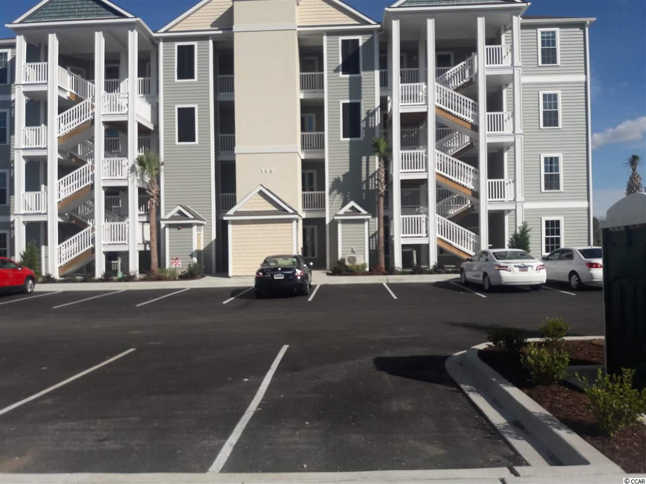 Located in one of the most successful condo developments in the Myrtle Beach area, this third floor end unit is a 3 bedroom 2 bathroom beautiful condo in the very popular Queens Harbour! Building has an oversized ELEVATOR to all floors, outside storage, split bedroom floor plans with entry to the Master Suite from the Family Room, 9' smooth ceilings and a screen porch. The location is superb with shopping, dining and recreation steps away. The amenity package includes a resort style swimming pool with club house and conveniently located picnic areas with grills.