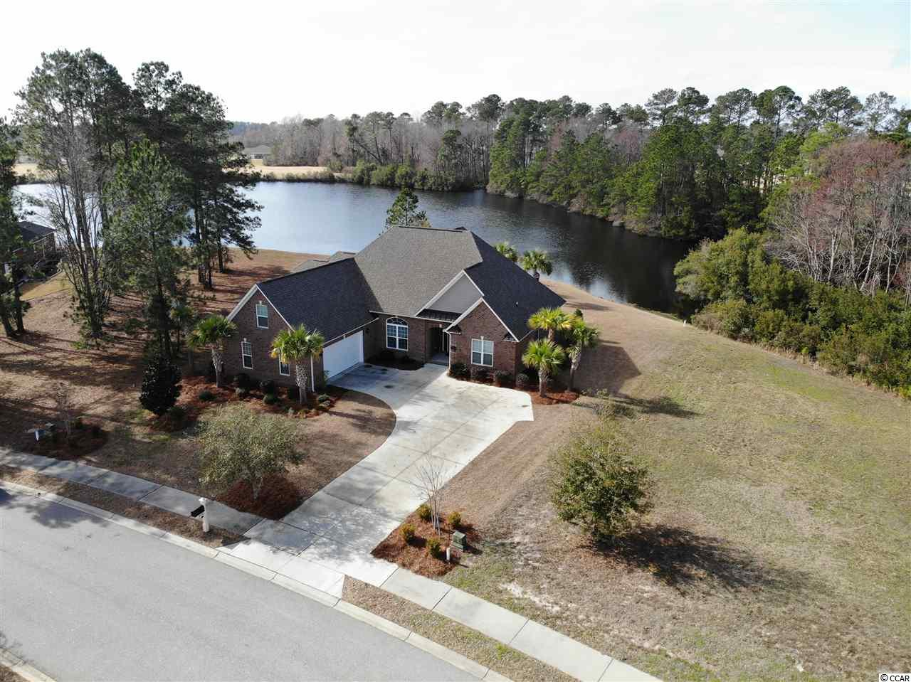 Sitting on a fantastic lake homesite, 1032 Muscovy Place is ideally positioned at the end of a quiet cul-de-sac street. This custom built home has all the features today's home buyers require.  The open split bedroom floor plan has terrific sightlines with tons of natural light.  A large kitchen and great room combination are sure to the favorite area of the home.  Custom cabinets, oversized work island, tile backsplash and under cabinet lighting will make cooking in this kitchen a dream come true.  Start your morning out right with breakfast with a view.  The breakfast nook and sprawling screen porch offer fantastic views of the lake.  The big master bedroom has a tray ceiling with rope lighting, large walk-in closet, and a to-die-for open-air shower.  On the opposite side of the home, the spacious guest bedrooms share a hall bathroom.  Rounding out the main living area is a formal dining room with a tray ceiling and a half bath for guests.  Endless potential uses await you upstairs.  The fourth bedroom is adjoined to a bonus room with a wet bar. Perfect for a media room, play area, pool table, and countless other options this room will rival the central living space as the place to be.  1032 Muscovy Place upmarket features and improvements include upgrading landscaping, hardwood floors, granite countertops, custom cabinets, and much more.  Homeowners are afforded a myriad of world-class amenities starting with a multi-million dollar clubhouse.  Three pools, slide, splash zone, fitness center, beach, day docks, playground, on-site boat storage, basketball court, and lighted tennis courts are all privileges of ownership at Wild Wing Plantation.  In addition to 180 acres of freshwater lakes and close to 14 miles of shoreline Wild Wing Plantation features 27 holes of championship golf.  The golf club features driving/putting/chipping practice areas, pro shop, a Pub, and Grill perfect for those times you don't feel like cooking.  Start living the life you deserve at 1032 Muscovy Place.