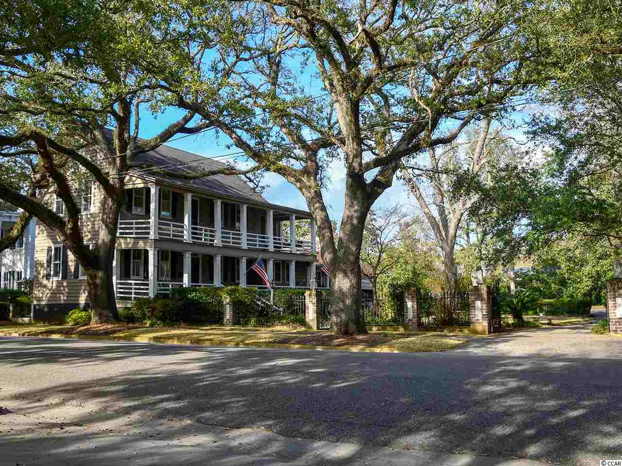 A unique opportunity to own a historic Georgetown property...  This charming lovingly restored three-story home was built between in 1740 and 1750 and retains many of unique architectural features. Referred to locally as the Sampson-Hamby-Ward House, it is constructed of black cypress siding and retains original doors. In addition to a living room, dining room and den, the 3 bedroom, 2 bonus room, and 3 bath residence features both hardwood and heart of pine flooring. Mantles and molding details are noteworthy. Three fireplaces are fitted with gas logs. The design of the balusters of the stairway is identical with that of the Chancellor de Saussure House, (18 Montague Street, in Charleston) which is known to have been built before the Revolution. The double-tiered piazzas of this Georgian style dwelling overlook a well-manicured garden of native plants.  The property also features what is presumed to be the original kitchen building containing a central chimney stack with double-braced cooking fireplaces. This is a grand example of early service architecture. Local artisans were engaged to create the hand-crafted fence and entry and driveway gates. Pieces of marble found in the original kitchen enhance the columns which bear gas lanterns.  Architectural details and descriptions from the Historic American Building Survey completed in 1963 can be given upon request. This is a large city property which must be seen to be fully appreciated.
