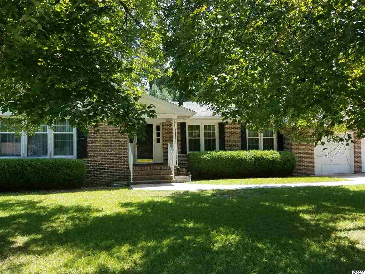 All brick home, peaceful, small neighborhood setting inside the City of Loris, SC. Two (2) completely new, floor to ceiling bathrooms, Master shower has been regrouted, cabinets refurbished, new vinyl floor.  New front door, new shutters,  new interior doors throughout house, Interior: all new fresh paint.  Crown molding added to formal living room, large foyer, family room, kitchen and the two new bathrooms.  Large eat in kitchen, with plenty of cabinets, and large pantry. All kitchen appliances are approximately 5yrs.  Generous size Carolina Room adds relaxation to the peaceful location of this property.  Large fully fenced in backyard great for children and/or pets. Oversized laundry room, washer & dryer included.  Front & Back exterior has fresh paint and back half of house has new roofing. Two car garage with workbench area has new walls, fresh paint and sealant on floor.   Easy access under home with lighting added. Also, a 12x15 shed freshly painted as well, included with home.  Home is move in ready!! During the current ownership, no incidents of any water intrusions to the land or property have occured.   All measurements are approximate & not guaranteed. Buyer responsible to verify.