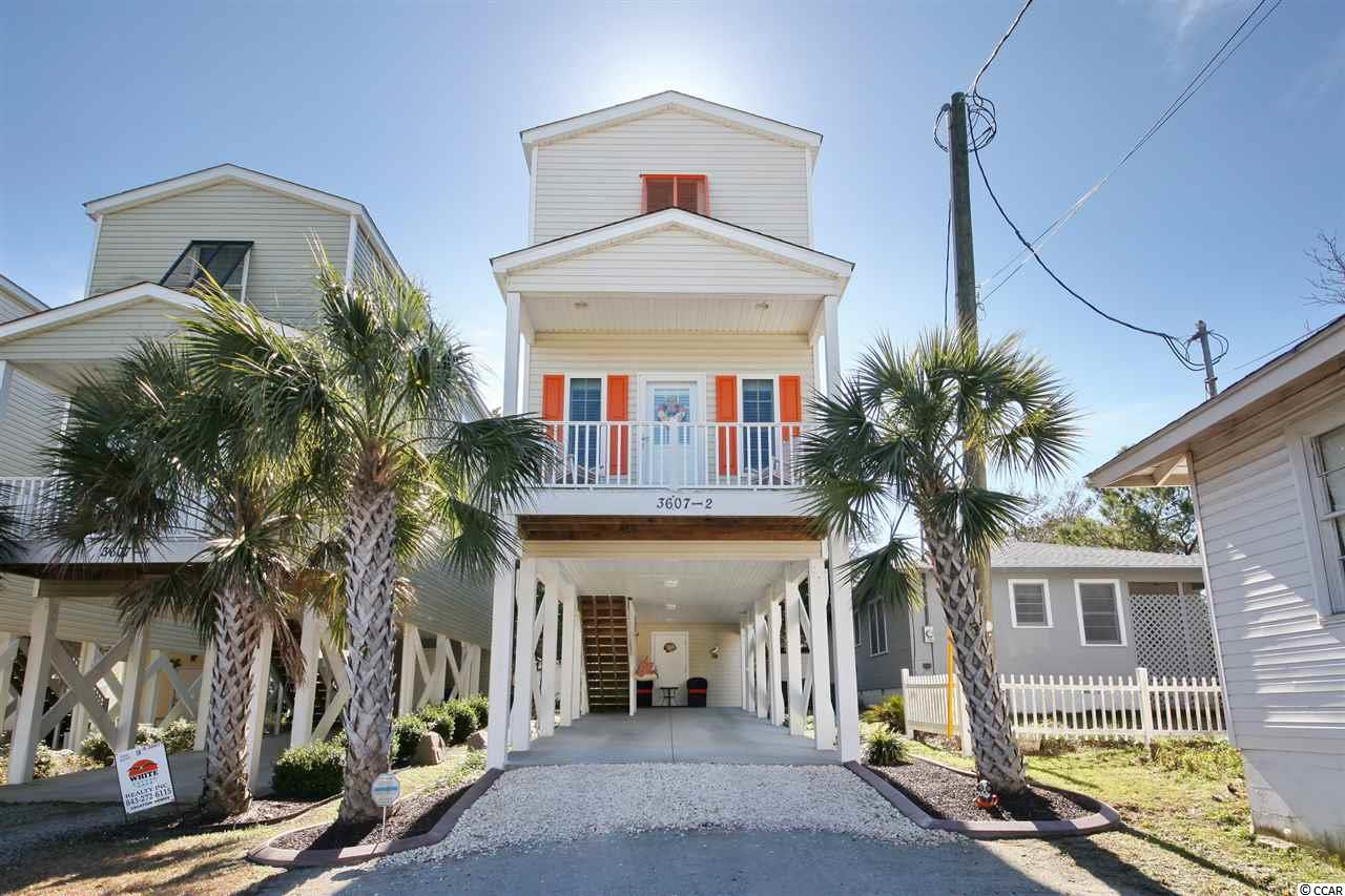 Your getaway is here! This home in Windy Hill is completely furnished, and ready for you! Perfect location-across from Barefoot Landing, in North Myrtle Beach, this single family home is 3 bedrooms, and 2 baths. Ceiling fans in every bedroom and living room, bead board doors, plantation shutters throughout, hurricane shutters, granite counter tops in kitchen, and stainless steel appliances complete the package. Lawn is well manicured, with curbing surrounding the house. Bring your boat, your golf cart, and your pets-with NO HOA, you are allowed short and long term rentals as well. Beautifully decorated, you will feel right at home-just bring your clothes and come on down! Located East of Hwy 17, just a short golf cart ride to the beach! What more can you ask or? Call now to see this amazing property!
