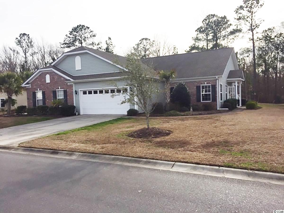An absolutely immaculate 3BR/2BA paired ranch home in the Carolina Crossing subdivision. This meticulously maintained property is situated on an oversized lot that extends beyond the treeline in the back yard; providing ample space for outdoor activities. The interior features an upgraded kitchen with stainless steel appliances, solid surface Corian kitchen countertops, glass top range, and adult height cabinetry. You will also find ceramic tile in the kitchen, bathrooms, laundry room and entry foyer with laminated hardwood floors in the living room. The home has a covered porch with view of the expansive back yard, custom fit, galvanized steel hurricane shutters, and a built-in, behind the walls TAEXX pest control system. The HOA fee includes exterior maintenance of the home, the home's lawn care with scheduled fertilizer, insecticide, pre-emergent and broad leaf weed control treatments, lawn mowing, shrubbery bed maintenance, garbage collection, termite preventive treatment, an in-ground irrigation system, quarterly pest control visits, and insurance. Also included in the HOA are street lights, street repairs, and swimming pool care and maintenance. This home certainly offers a great deal and is an absolute must see.