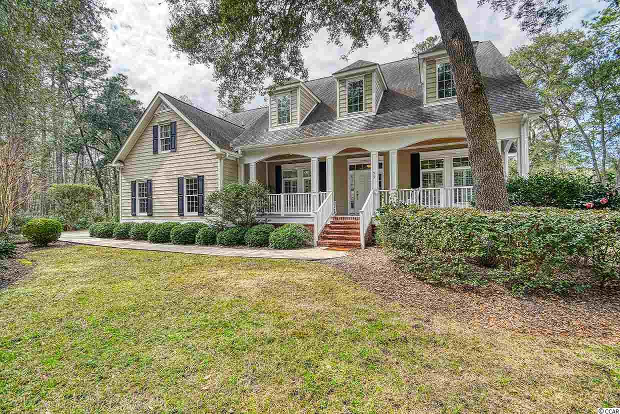 Centrally located within the DeBordieu Community with easy access to the beach and all amenities, plus being on a quiet cu-de-sac on a beautiful lakefront property with numerous live Oaks, Camellias, and other plantings, this charming Lowcountry residence epitomizes the best of comfortable and functional living. The spacious living room with wet bar and fireplace leads into the large and inviting kitchen. The adjoining deck is ideal for entertaining and enjoying the lake view. The Master bedroom suite is also on this main level as is the separate dining room and convenient guest room. Upstairs there is a comfortable sitting area and an additional two bedrooms and baths plus a large bonus/playroom. All of the spaces are well designed for enjoying the company of family and friends. The home has been meticulously maintained by its owner and represents a great opportunity to be part of the DeBordieu Community and all it has to offer.
