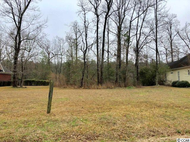 """This residential lot is located along the tranquil Waccamaw River.  You can build your dock and enjoy this property as its perfect for fishing, bird watching, and kayaking during the summer months.  This lot is perched at one of the highest levels along the river in the county, which provides the owner with an exquisite view of the native flora and fauna. The nearby English-style clubhouse, also located along the Waccamaw, has condos on the second level for visiting golfers—perfect for your out of town guests.  You will also enjoy the driving range and course, both of which are just a short walk from your lot!  Shaftesbury Glen is a Clyde Johnson signature course with """"large, old-style rectangular tee boxes, wildly enjoyable wide open fairways – for love of the long ball – along with elevated, super-sized, immaculate Bent grass greens.""""  Approved builders can also offer the new owner Free Golf Membership for Life!  Contact the listing agent for more details."""