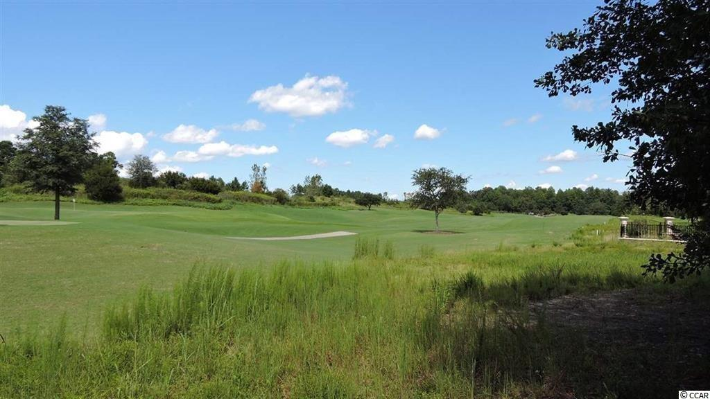This Homesite is perfectly located overlooking Members Club Golf Course, being close to #1 hole. Lot #35 is walking distance to the Club House. Premier Location in Grande Dunes. Nestled among Prestigious Mediterranean Estate Homes. Custom Builder Available. No Time Frame to Build. HOA includes Privileges to Ocean Club with Restaurant and Pool and Direct Access to the Beach. Grande Dunes has a 24 hour manned gate and a roving security guard. You will enjoy walking and jogging on the miles and miles of sidewalk winding thru the Neighborhood. This property is located in South Carolina's premier coastal community in Myrtle Beach; Grande Dunes.  Stretching from the Ocean to the Carolina Bays Preserve, this 2200 acre development is amenity-rich and filled with lifestyle opportunities unrivaled in the market.  Owners at Grande Dunes enjoy a 25,000 square foot Ocean Club that boasts exquisite dining, oceanfront pools with food & beverage service, along with meeting rooms and fun activities.  Additionally, the community has two 18-hole golf courses, including the area's only truly private course designed by Nick Price, along with several on-site restaurants, deep water marina, Har-tru tennis facility and miles or biking/walking trails!  Please visit our sales gallery located in Grande Dunes Marketplace next to Lowes Foods to learn more about this amazing community you can call home. The owner is a SC licensed Realtor.