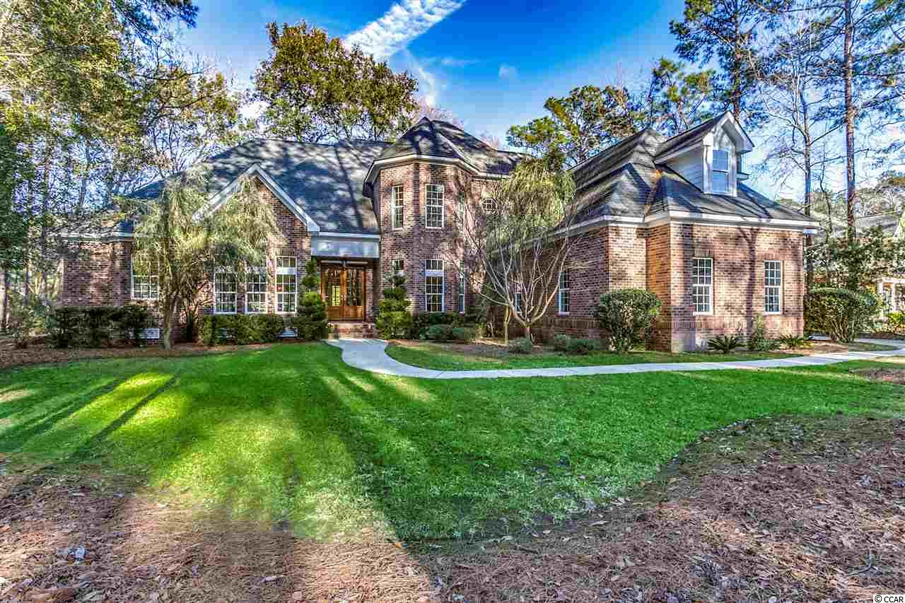 Welcome home to the amazing DeBordieu Colony community with its natural beauty left the way mother nature intended. This meticulously maintained all brick home sits among the live oaks with anincredible lake view. With 4 bedrooms/4.5 baths and an open floor plan this home makes for an excellent place for a family lifestyle or entertaining all your guests. The open concept floor plan has lake views from nearly every angle it seems. As you enter the home the large open living room invites you immediately with detailed trim work, gas fireplace and the view extends to the patio area and beyond. The gourmet kitchen has an island work area, granite counters, stainless appliances as well as a breakfast bar and breakfast nook area with yet again open lake views. The breakfast nook leads out to screened porch area that you could find yourself spending more time in the than entire house while you enjoy your morning coffee or quite possibly an afternoon cocktail. The master suite is also located on the first floor with a sitting area that leads out to the patio, walk in closet, large whirlpool tub, shower and double vanity sinks. Rounding out the first-floor level is the formal dining room, den/study and laundry/utility area. The second floor that is accessible by elevator or stairs has 3 additional bedrooms, each with their own private baths, as well as a large media room. This oceanfront gated community with its miles of beaches, private beach club with pools, tennis courts, boat access to the North Inlet and Atlantic Ocean, gym, dining, and the 18-hole Pete Dye course and much more will have you have you in awe at every turn. Reach out to your agent today and make sure you see this home!