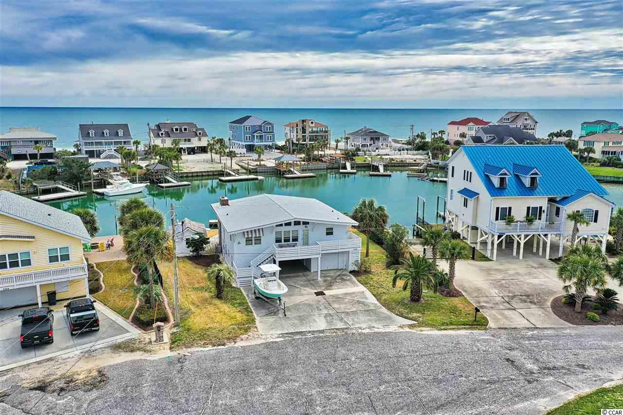 If you enjoy island living, this home is for you!  When walking through the front door, you are immediately greeted with beautiful views of the deep water canal and the Atlantic Ocean!  This home accommodates 14 guests with 5 bedrooms and 3 full baths.  The center of this home offers an open floor plan which leads directly to the large back porch which is complete with a wood burning fireplace for those spring and fall nights.  The porch overlooks the new massive deck which connects to the  brand new 48 ft floating dock--perfect for swimming, paddle boarding, and housing your boat or boats!  This home is located on deep water which leads you to the Atlantic Ocean in less than 10 minutes.  Also a new vinyl sheet sea wall, made with Everlast Vinyl, has just been installed and comes with a 50 year warranty.  Speaking of outdoor living, the detached Gazebo houses a full kitchen and a wrap around bar perfect for serving outdoor lunch and dinner--bring your fresh catch home and prepare it without ever going inside!  There is a separate room downstairs with an industrial stainless steel sink perfect for cleaning your fresh catch. There is a fabulous custom built in propane grill that is newly refurbished.  This home also has a new outdoor shower, new front porch, and fresh paint outside.  With tons of storage and a golf cart garage, the only thing needed to start enjoying this amazing Garden City home is your luggage!  Don't let this island gem slip away!