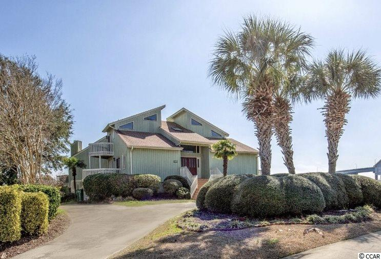 One of a kind raised beach home located in the Olde Harbour community on the Intracoastal Waterway in Little River, South Carolina. Olde Harbour is one of the most sought after waterfront communities in this area and close to all that North Myrtle Beach and Little River have to offer. This fully furnished, 4 bedroom/4bath, custom home features a unique architectural design with a floor plan that has a nice flow throughout the home. The first floor master bedroom has a large walk-in closet, gas fireplace, and a private balcony that overlooks the Waterway. The spacious en suite bathroom comes with a tiled shower, garden tub, and double sinks. There is an additional bedroom on the first floor next to the master and two bedrooms upstairs each with their own private bath. The kitchen offers space and functionality, with a stand alone island that has a built in cook top, under cabinet storage, large pantry and a breakfast nook that seats four. Right off the kitchen you'll immediately enter the family room that offers a great deal of natural light, a gas fireplace, and french doors that lead out to the wrap around deck. If you can't get enough of the beautiful views then the sunroom is where you'll spend most of your time, with floor to ceiling windows and cozy seating this is the perfect spot to relax with a good book or watch as the boats pass by. Only 20 minutes north of Myrtle Beach, this quaint town, is known for its fresh seafood, fishing charters, and it's annual blue crab festival. Little River is one of the few locations left along the Grand Strand where a slower pace of life still exists. Don't miss out on this amazing opportunity to live on the Waterway! Call today to schedule your showing!